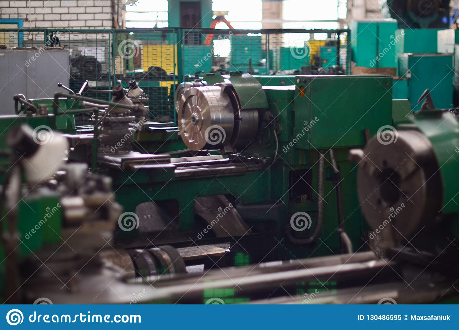 View of a large metal industrial machine in the shop for processing iron products