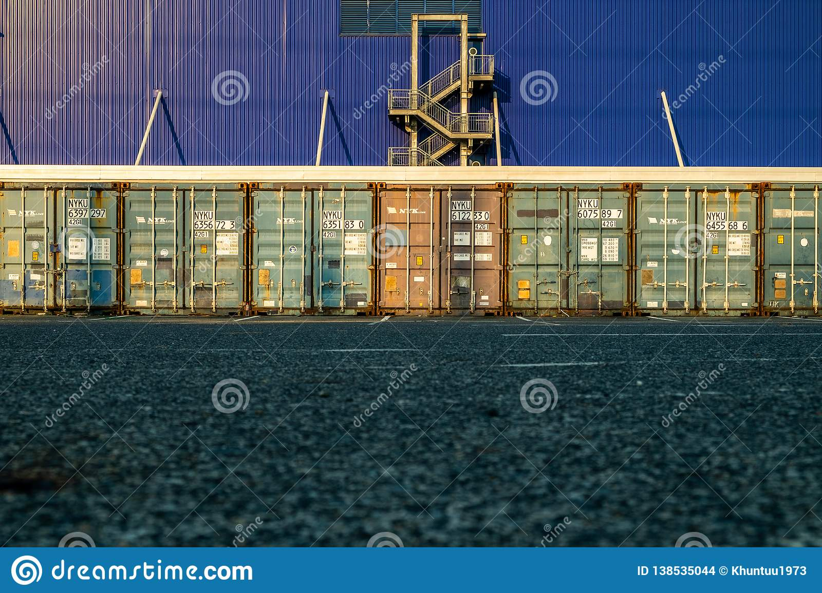 View Of Many Shipping Containers Doors With Fire Escape