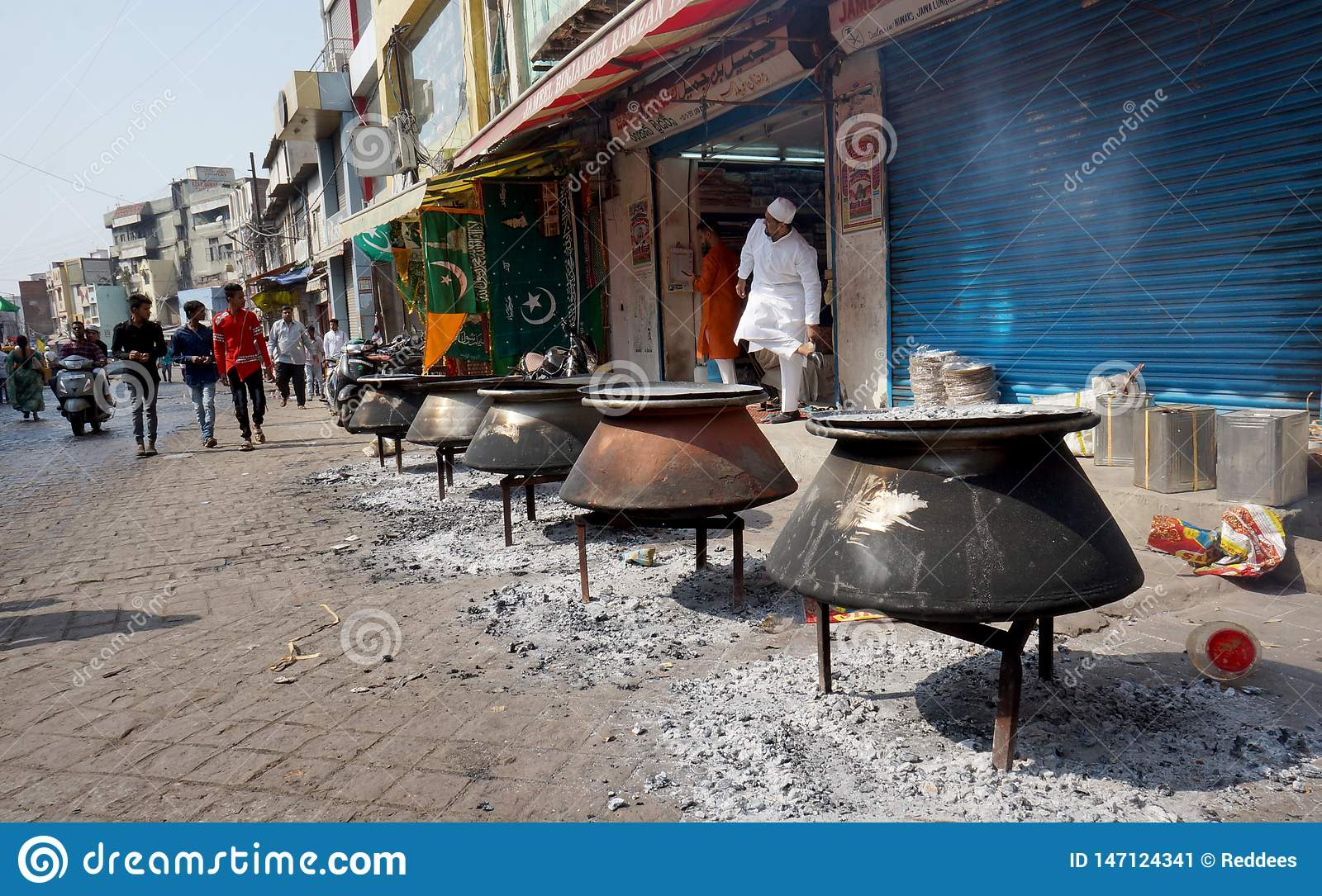 People cook food with fire wood,in the streets,on Mohammed Prophet Birth Day,for distribution or feeding peopl
