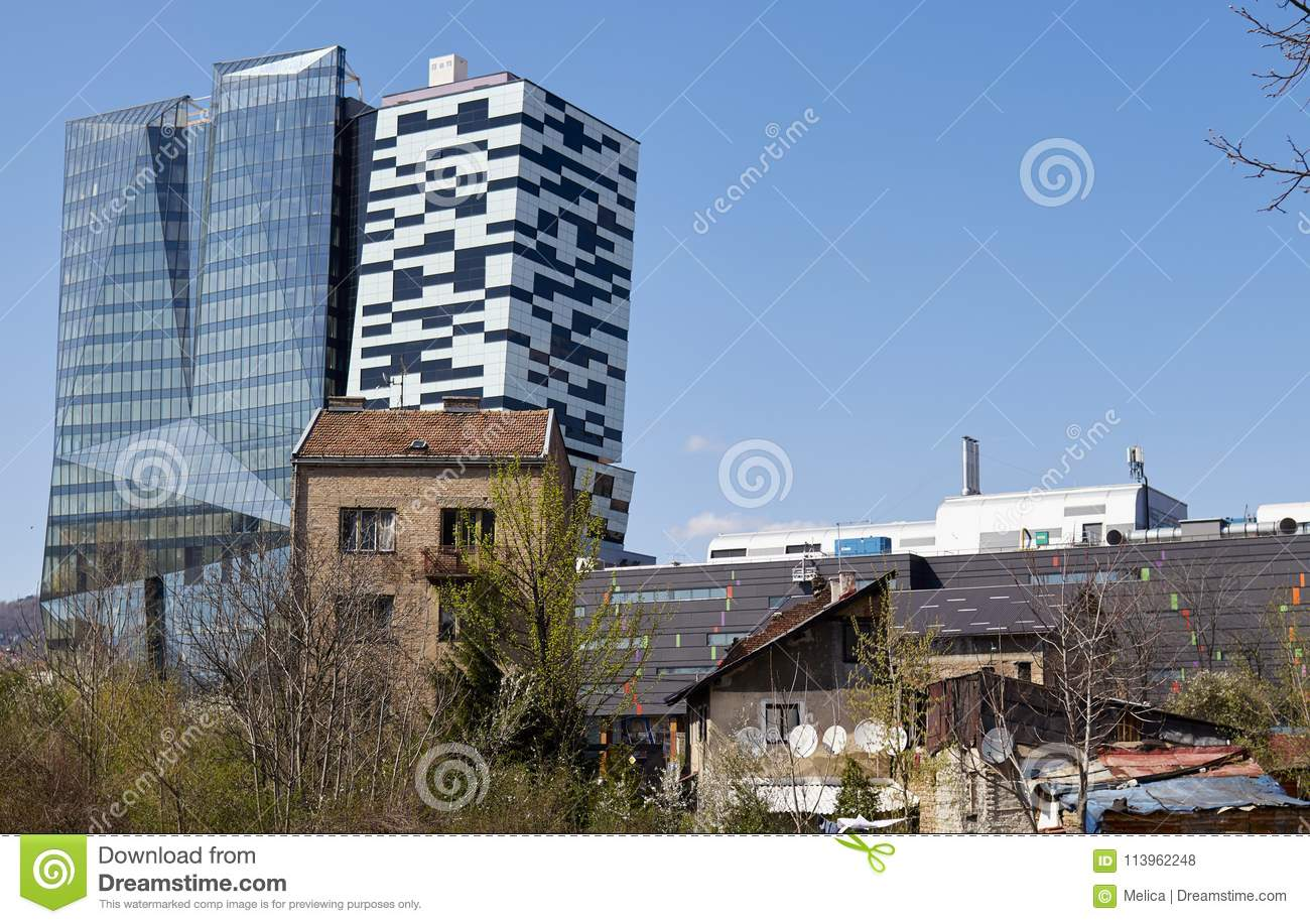 View of modern glass buildings and old brick houses new skyscrapers growing over the old buildings in sarajevo