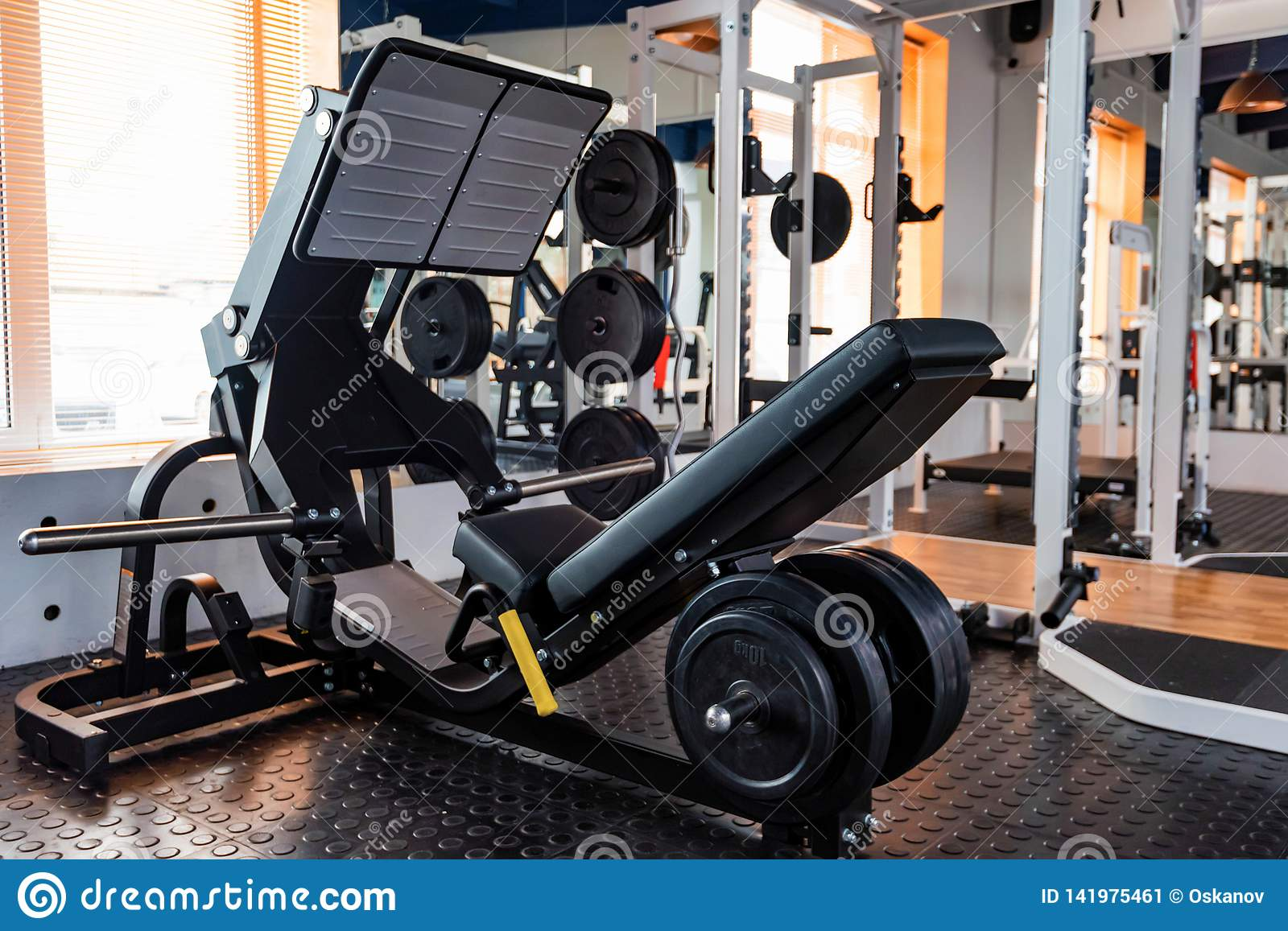 Empty Leg Press Exercise Machine In Modern Gym Stock Image