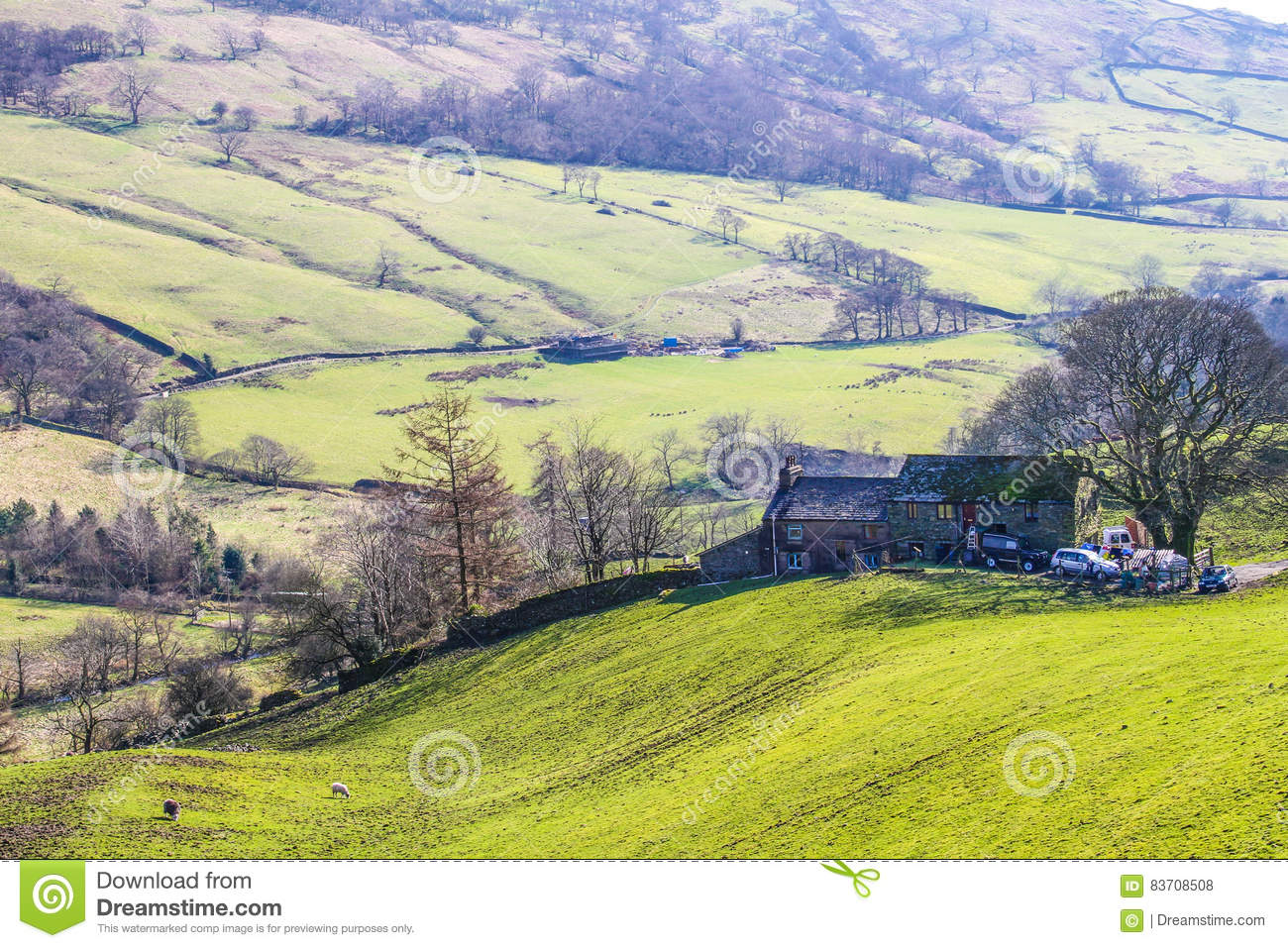 View From The Mountains Over Green Fields Stock Photo