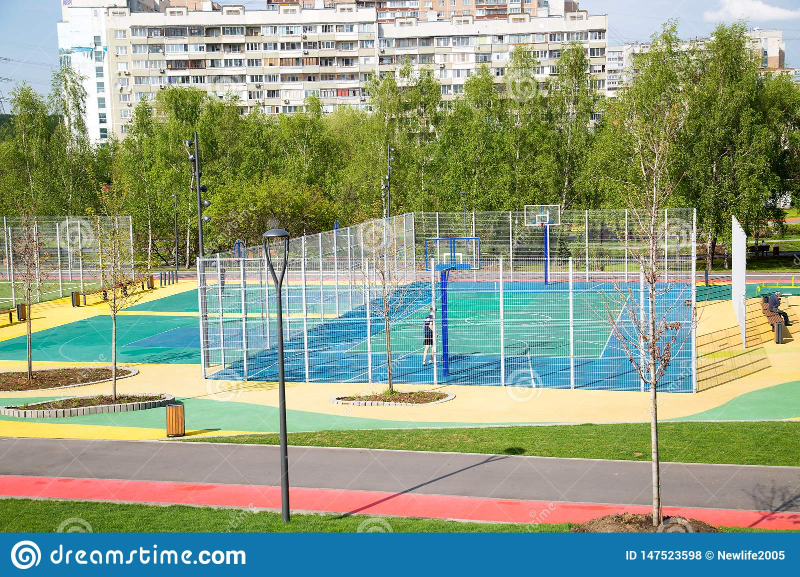 View of the multi-color sports ground in the Park on the background of houses on a clear Sunny day.