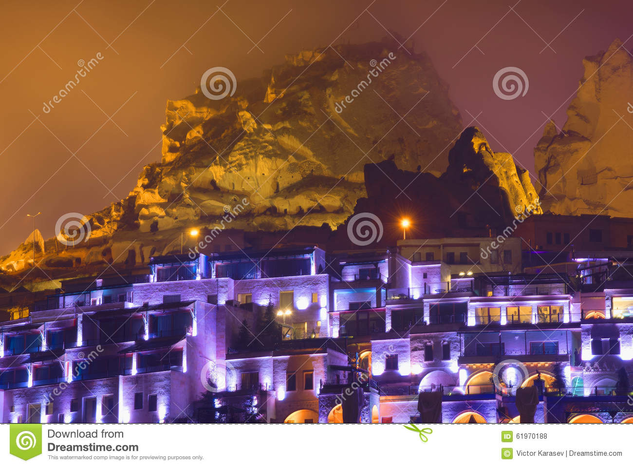 View of the old town of Uchisar foggy night. Cappadocia
