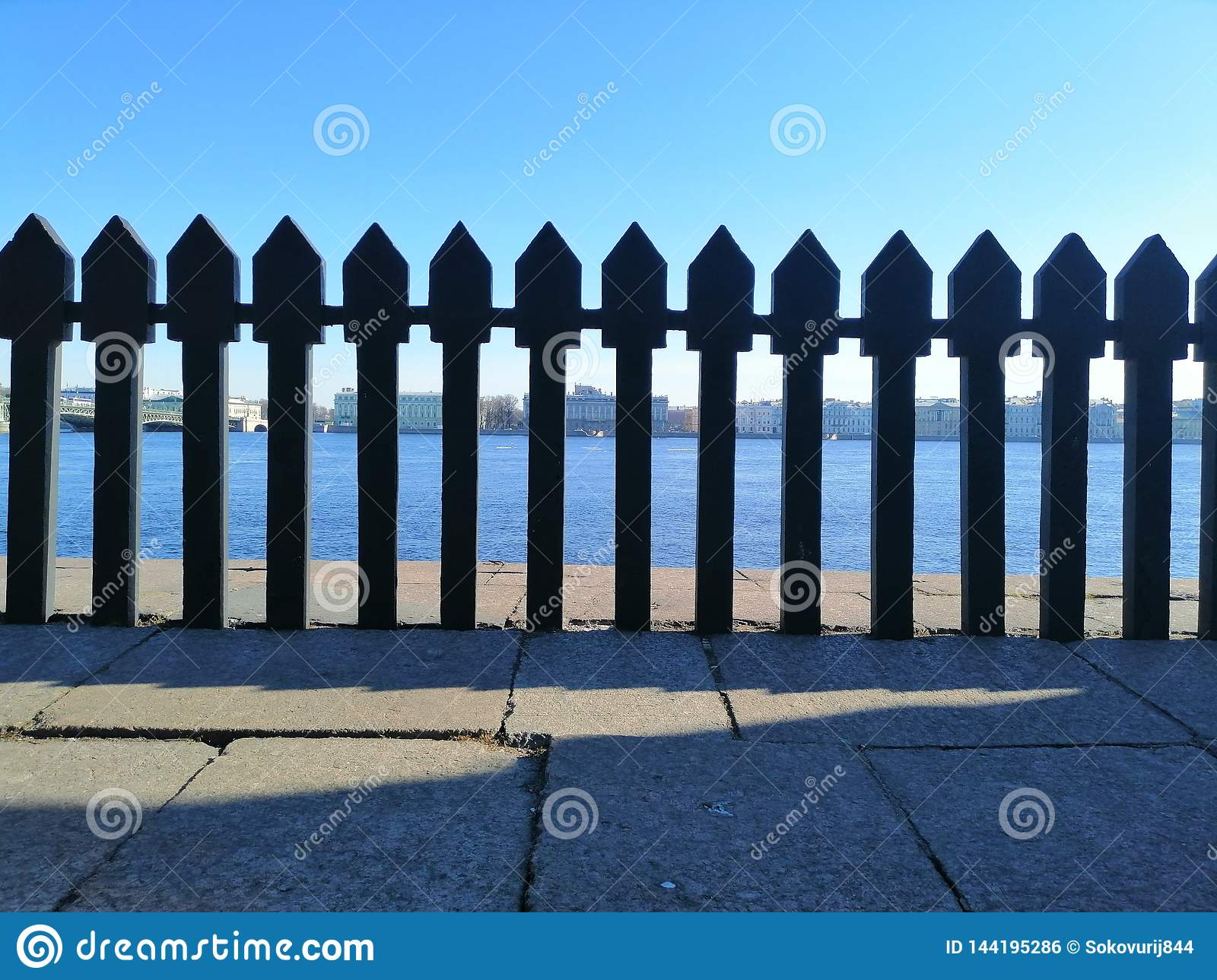 View of the opposite shore through the  fence