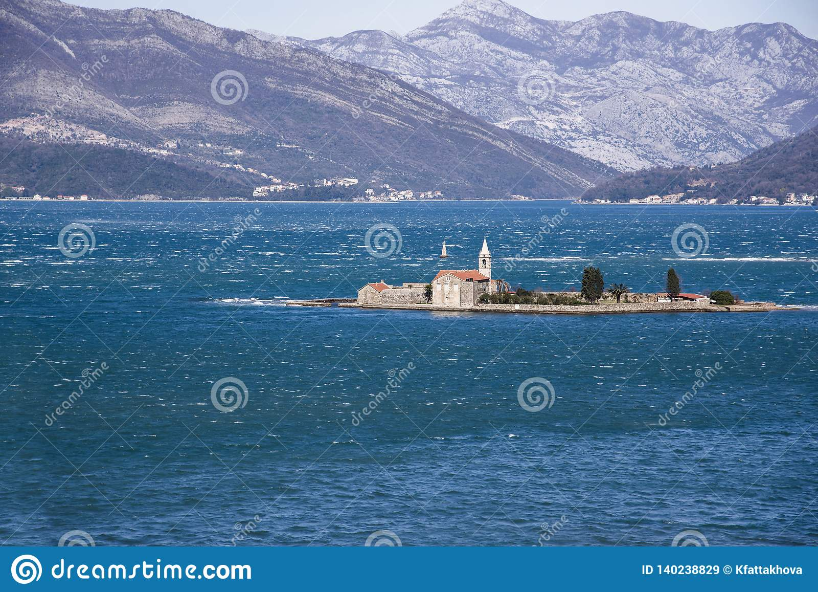 View of Otok Island Gospa od Milo Bay of Tivat, Montenegro, on a windy winter day. 2019-02-23 11:49
