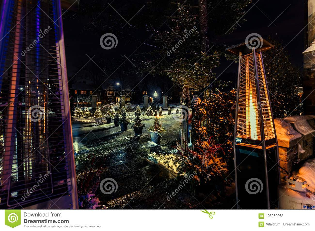 View of outdoor propane heater turned on against backyard background download comp aloadofball Choice Image
