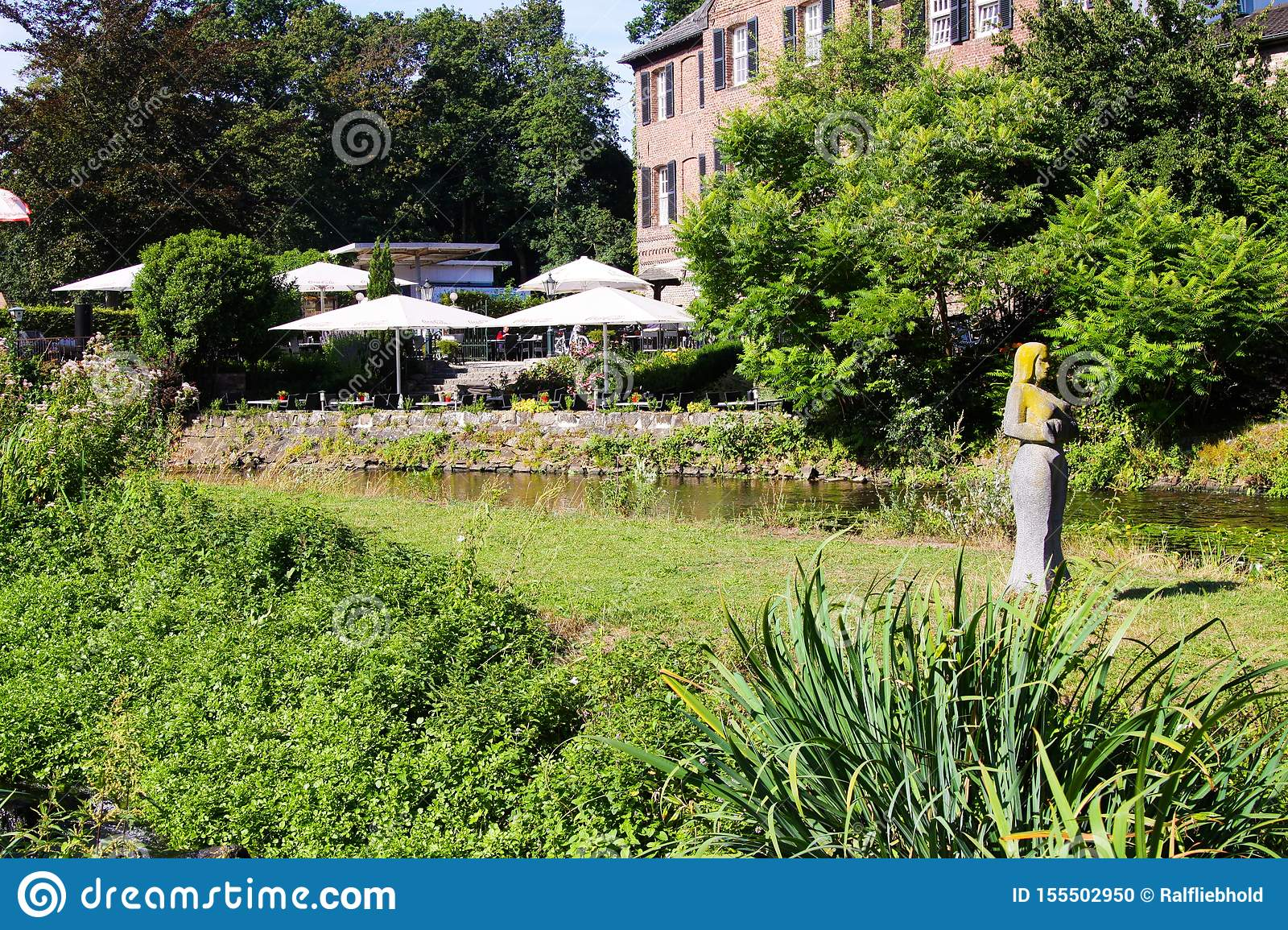 View Over Creek And Green Park On Outdoor Terrace Of Restaurant With Umbrellas And Old Bred Editorial Image Image Of Brafrac14 Tree 155502950
