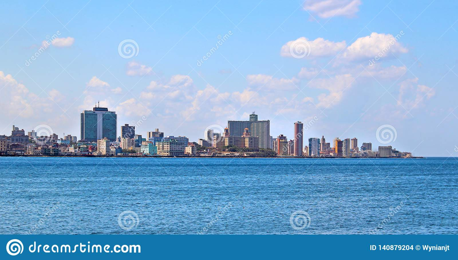 View of the panoramatic Havana in Cuba. There is blue sky and blue ocean