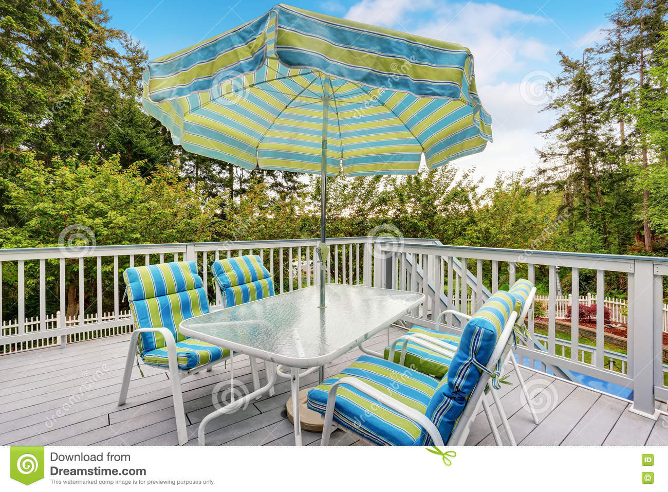 view of patio table set with umbrella in green and blue colors