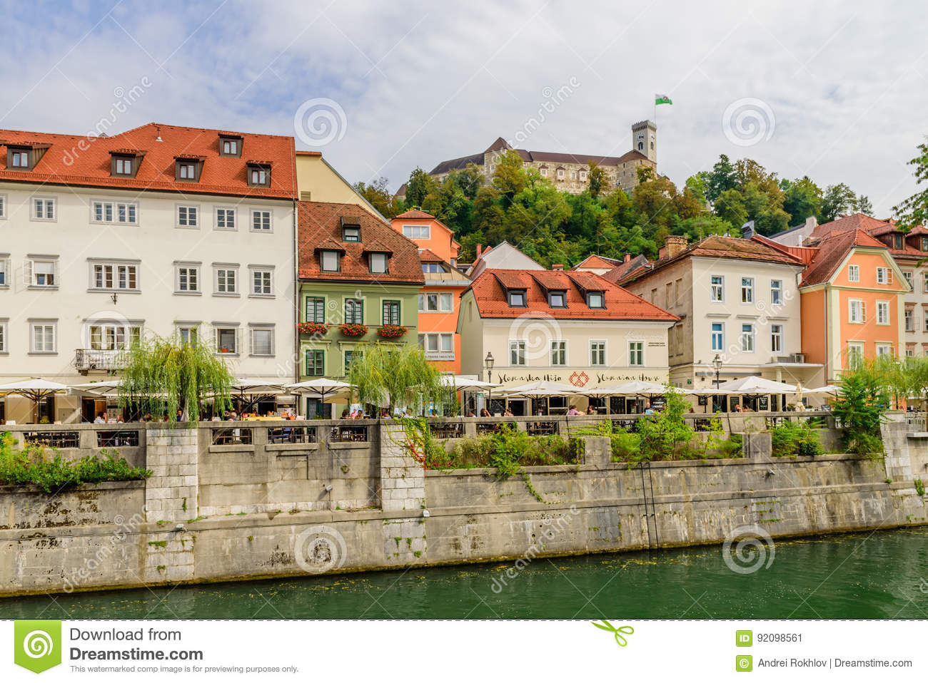 View of the picturesque embankment of the Ljubljanica river and Ljubljana castle.