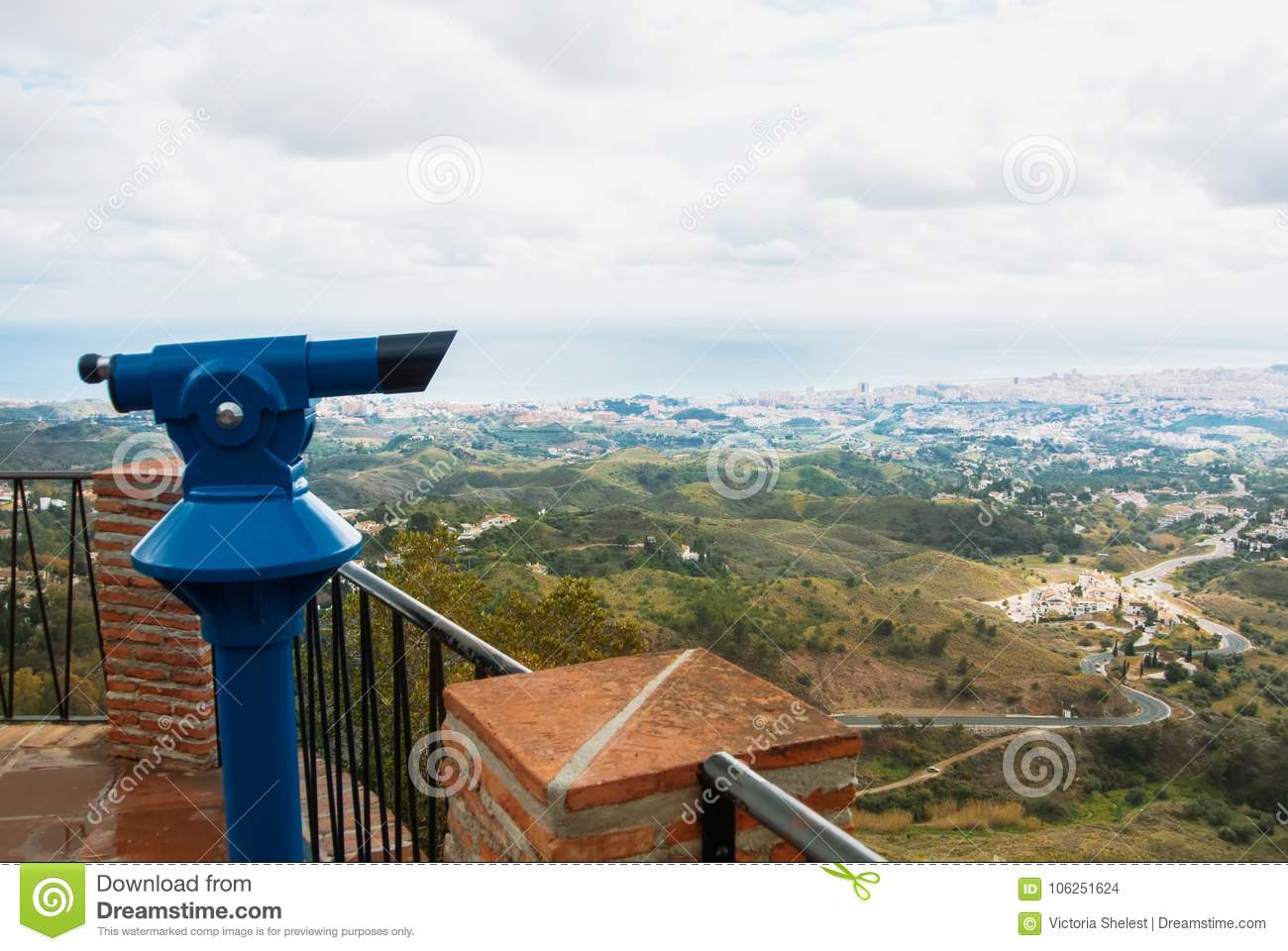 View point in the park of Mijas, a blue coin telescope and a beautiful panoramic aerial view to Mediterranean sea and a road to F