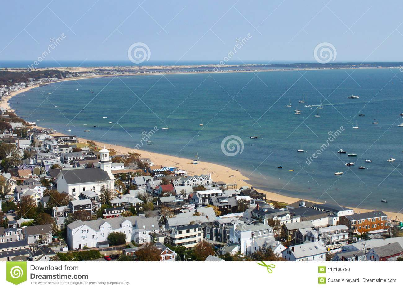 The View of Provincetown beach and the curve of the bay at the tip of Cape Cod from the top of the Pilgram Monument