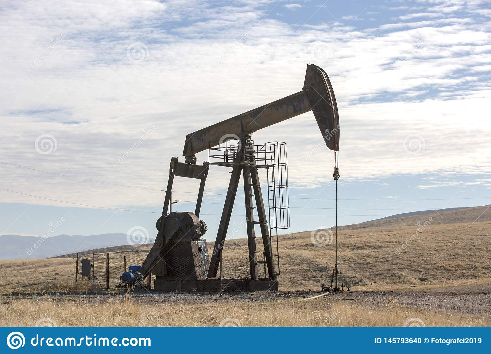 View of Pumpjack at Daylight Oil Industry