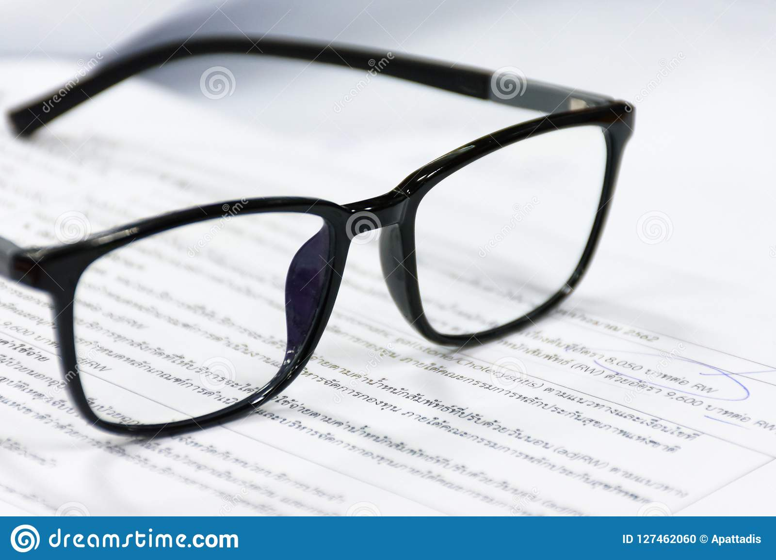 0b36dd42d0d9 Reading Glasses On The Paper Sheet. Stock Photo - Image of looking ...
