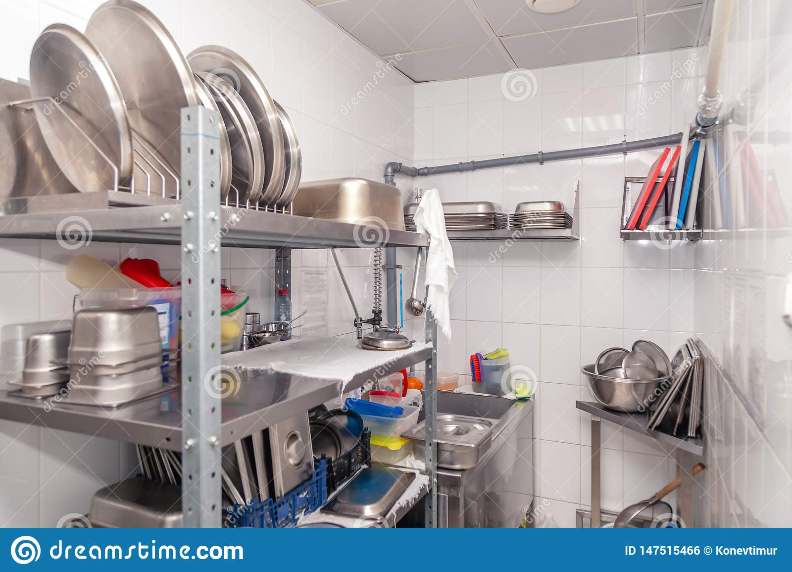 View Of Restaurant S Professional Washer Sink Brushes Metal Shelving And Shelves With Kitchen Utensils Cups Cutting Board Stock Photo Image Of Place Shelves 147515466