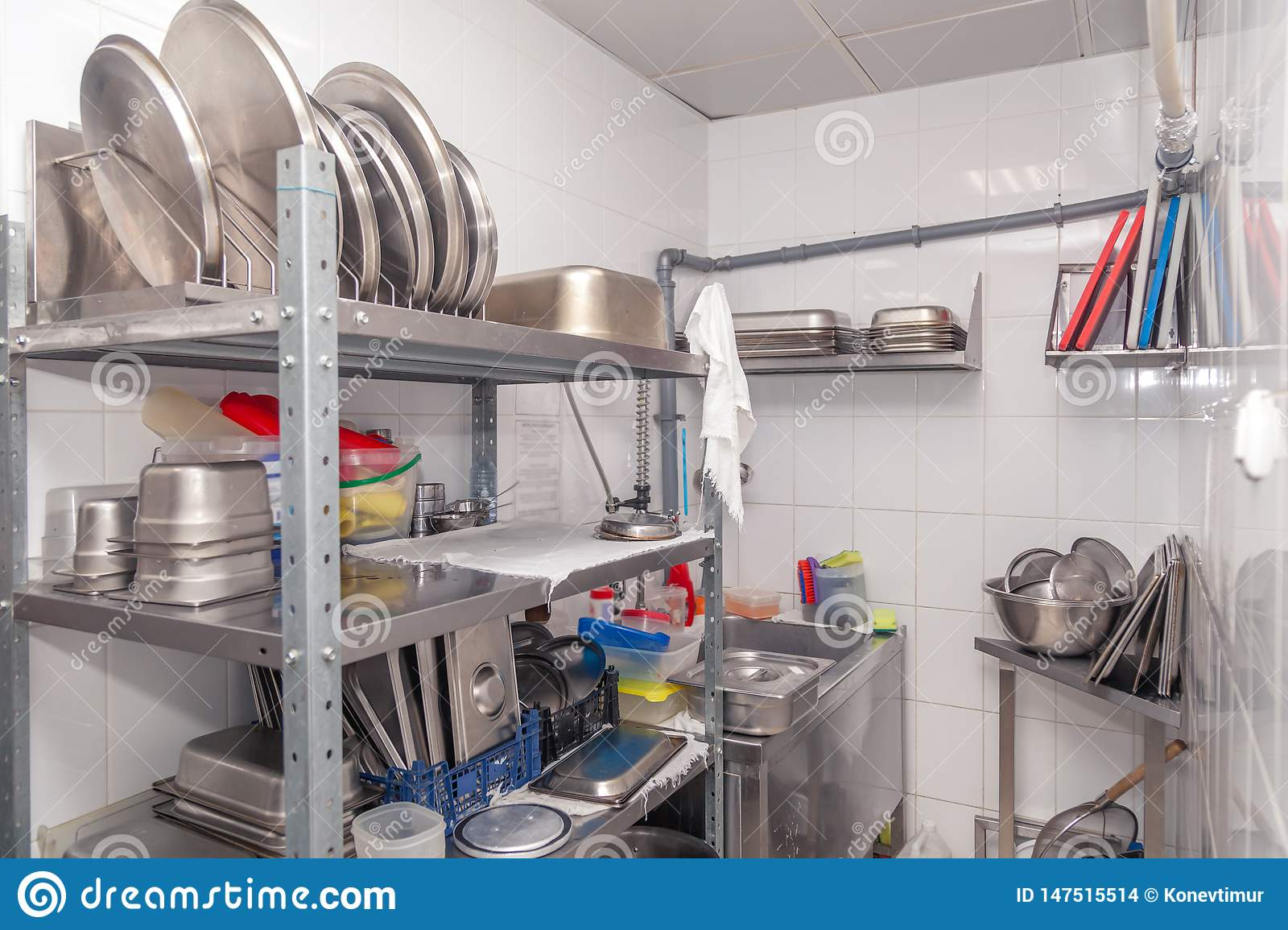 View Of Restaurant S Professional Washer Sink Brushes Metal Shelving And Shelves With Kitchen Utensils Cups Cutting Board Stock Photo Image Of Shelves Restaurant 147515514