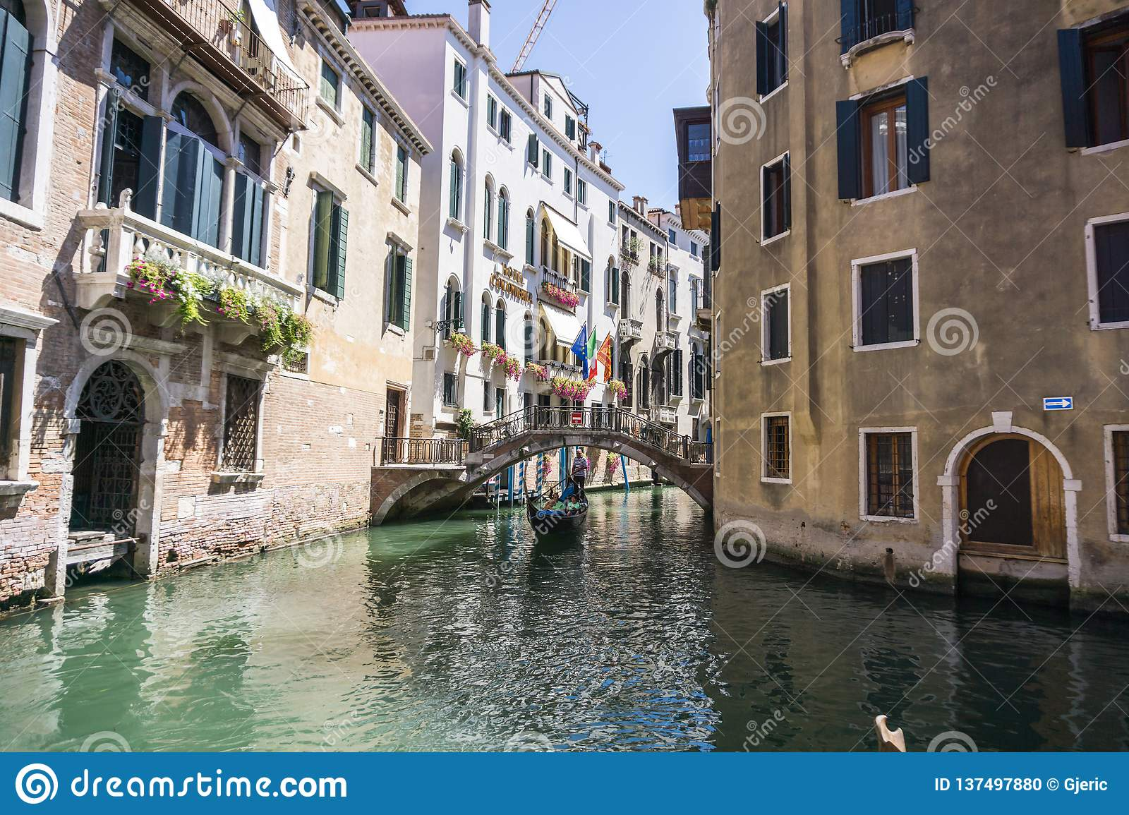 View of the Rio Marin Canal with boats and gondolas from the Ponte de la Bergami in Venice, Italy. Venice is a popular
