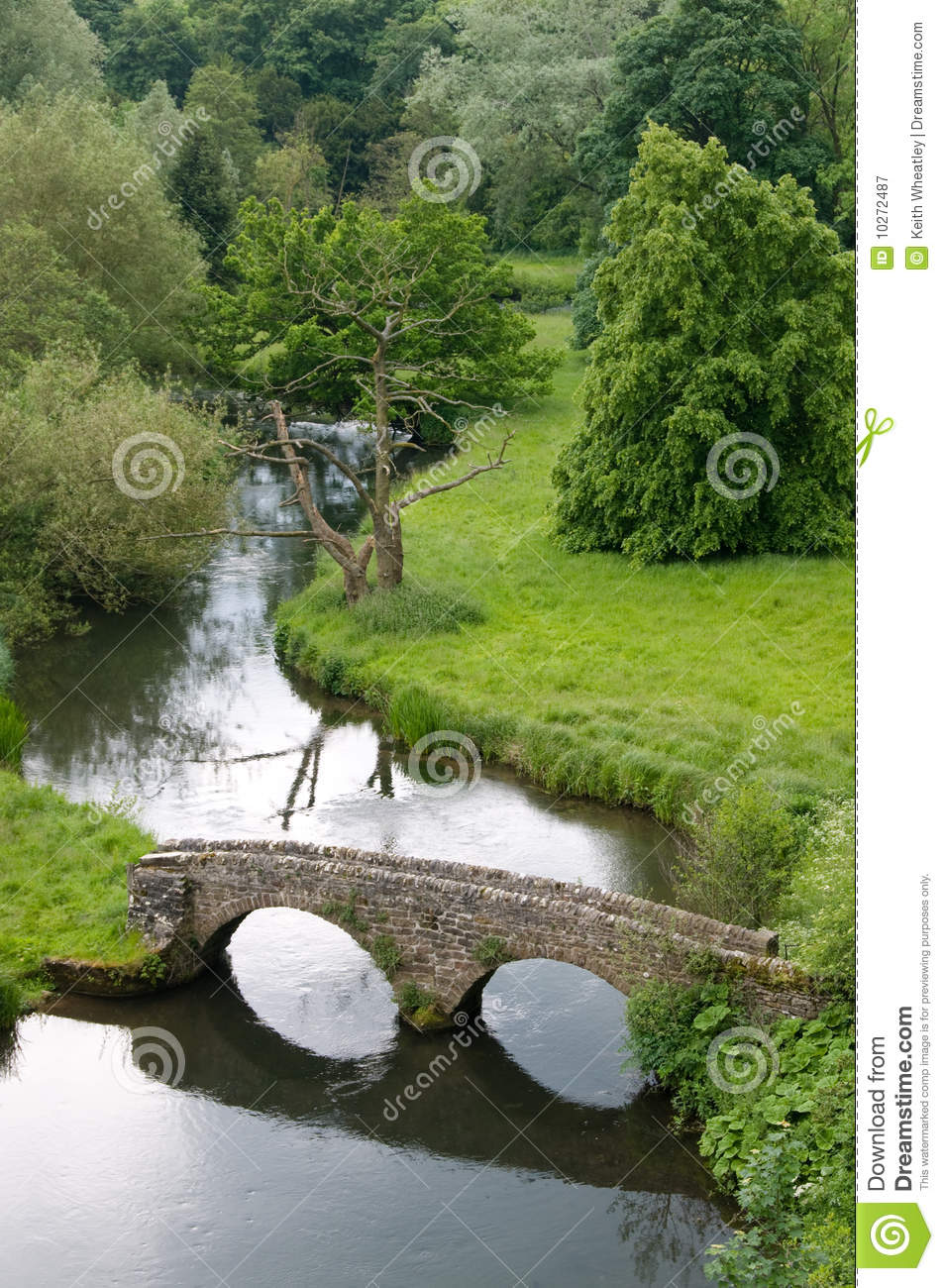 View of river and stone arched bridge
