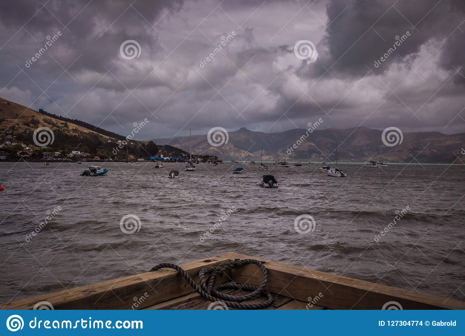 View of sailing boats in gloomy day