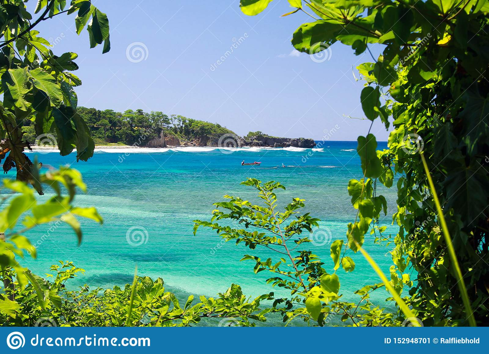 View On Secluded Islet With White Sand And Turquoise Water
