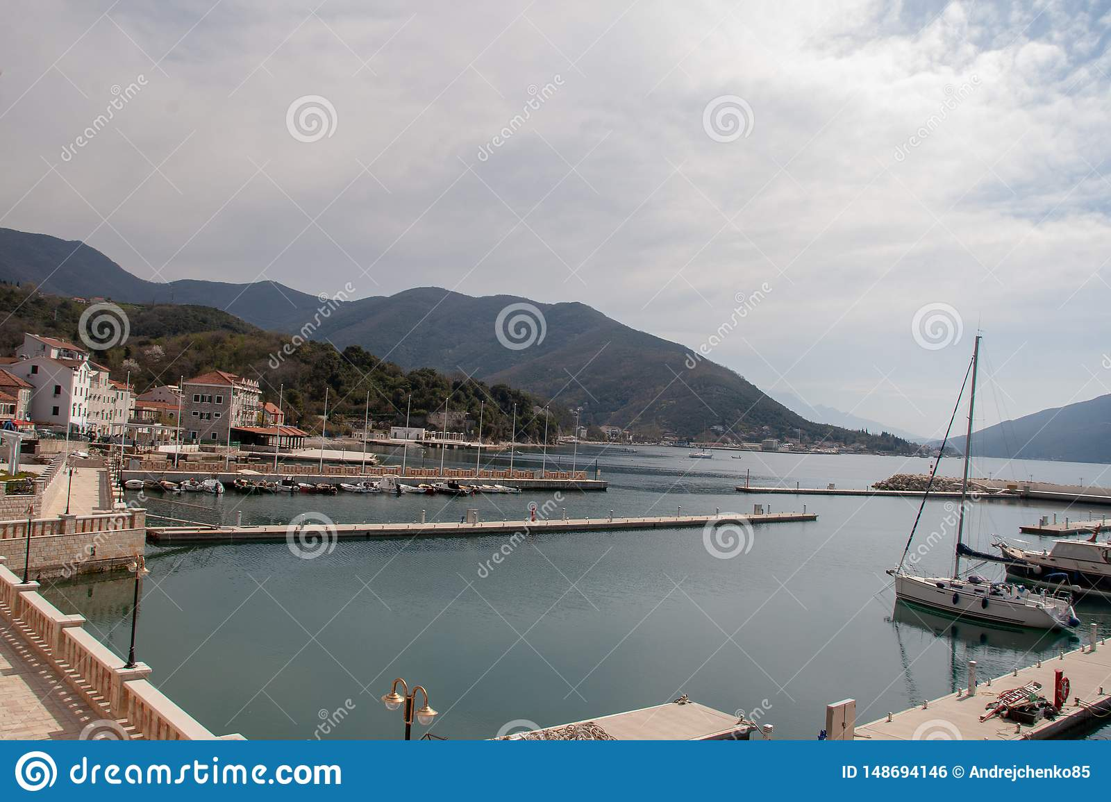 View on a small city in Montenegro near the sea and mountains.