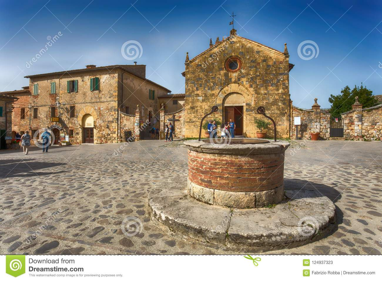 View of the small medieval village with stone walls of Monteriggioni in province of Siena, Tuscany, Italy.