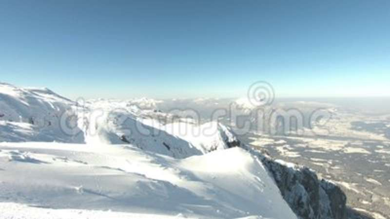 The view from a snow capped Untersberg Mountain in Austria. Definition bbb484ef6e1