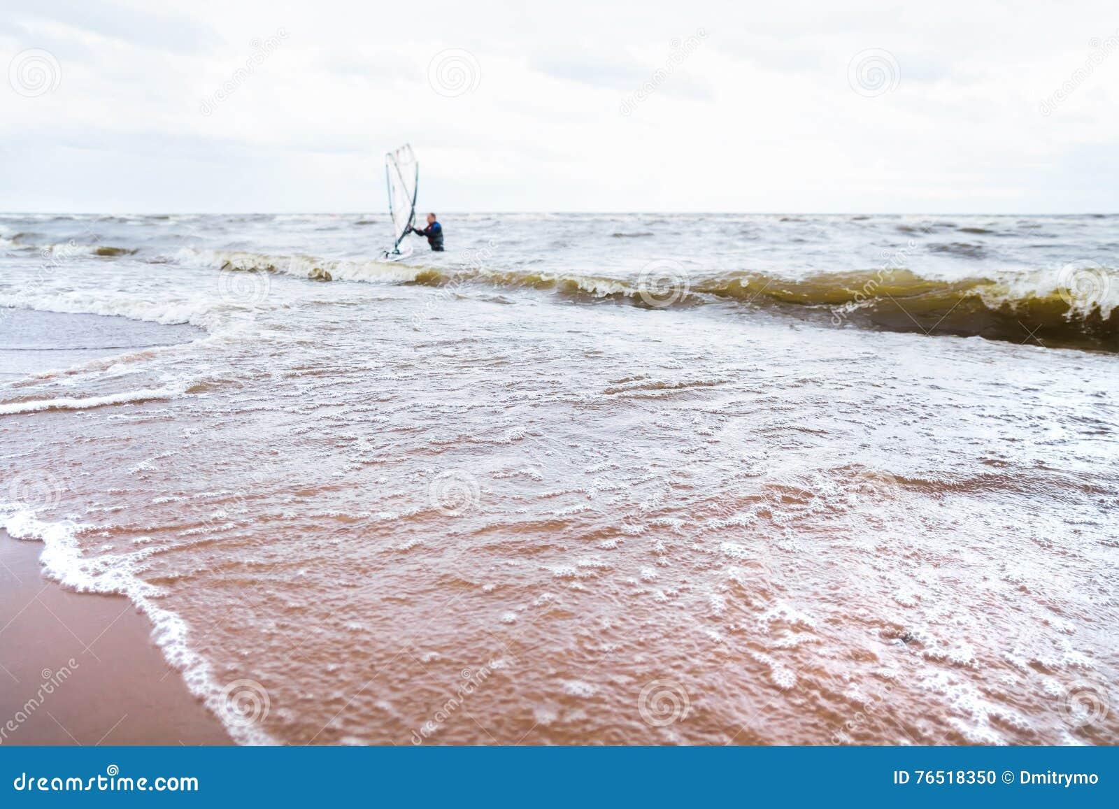View of storm seascape. Windsurf board