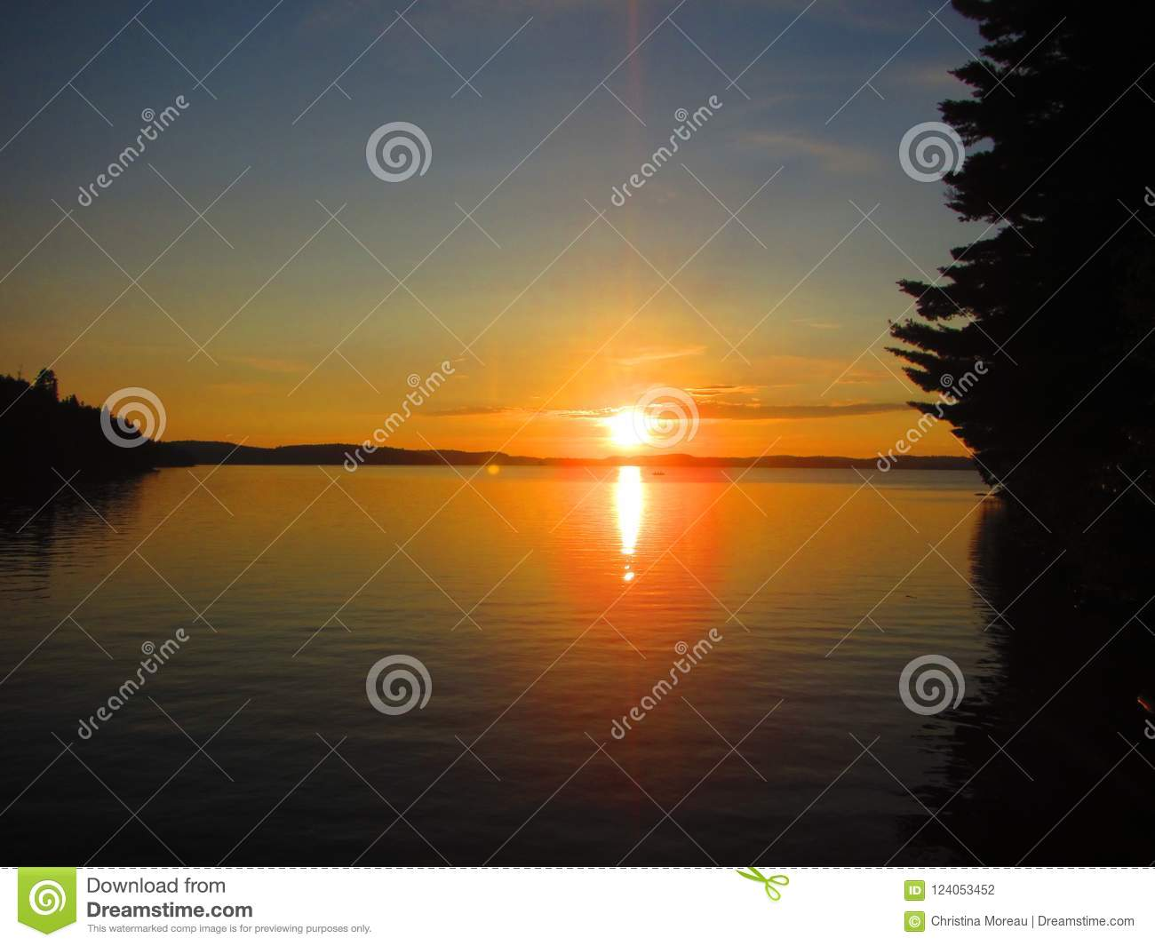 View of a sunset over a freshwater lake in North America