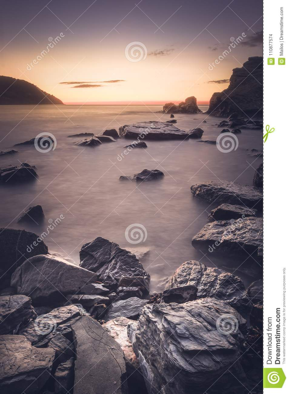 View of a sunset and in the foreground of the rocks