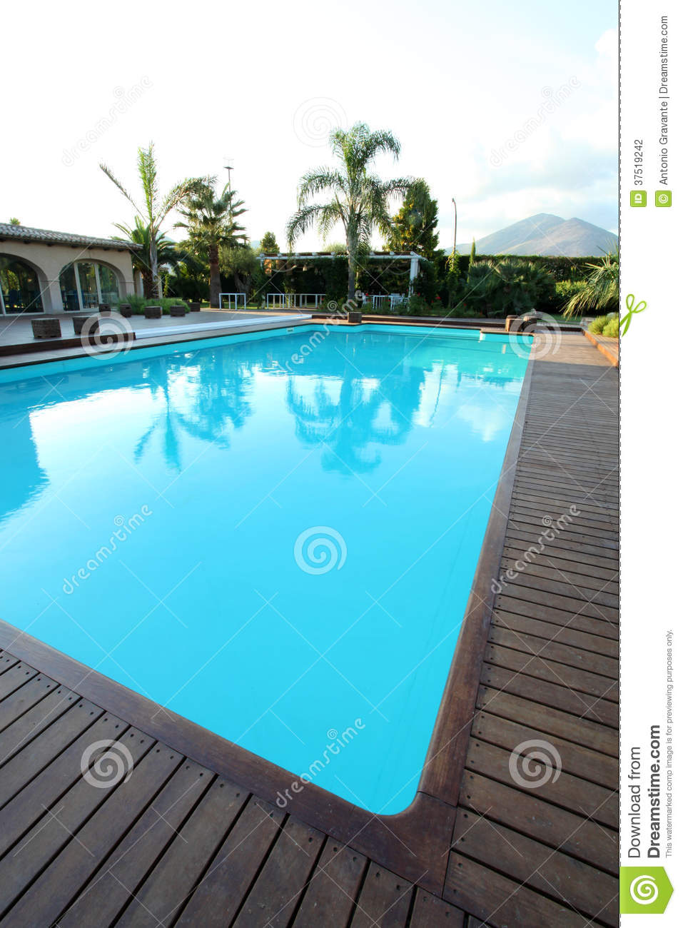 View of swimming pool with teck wood flooring stock photo for Swimming pools obi