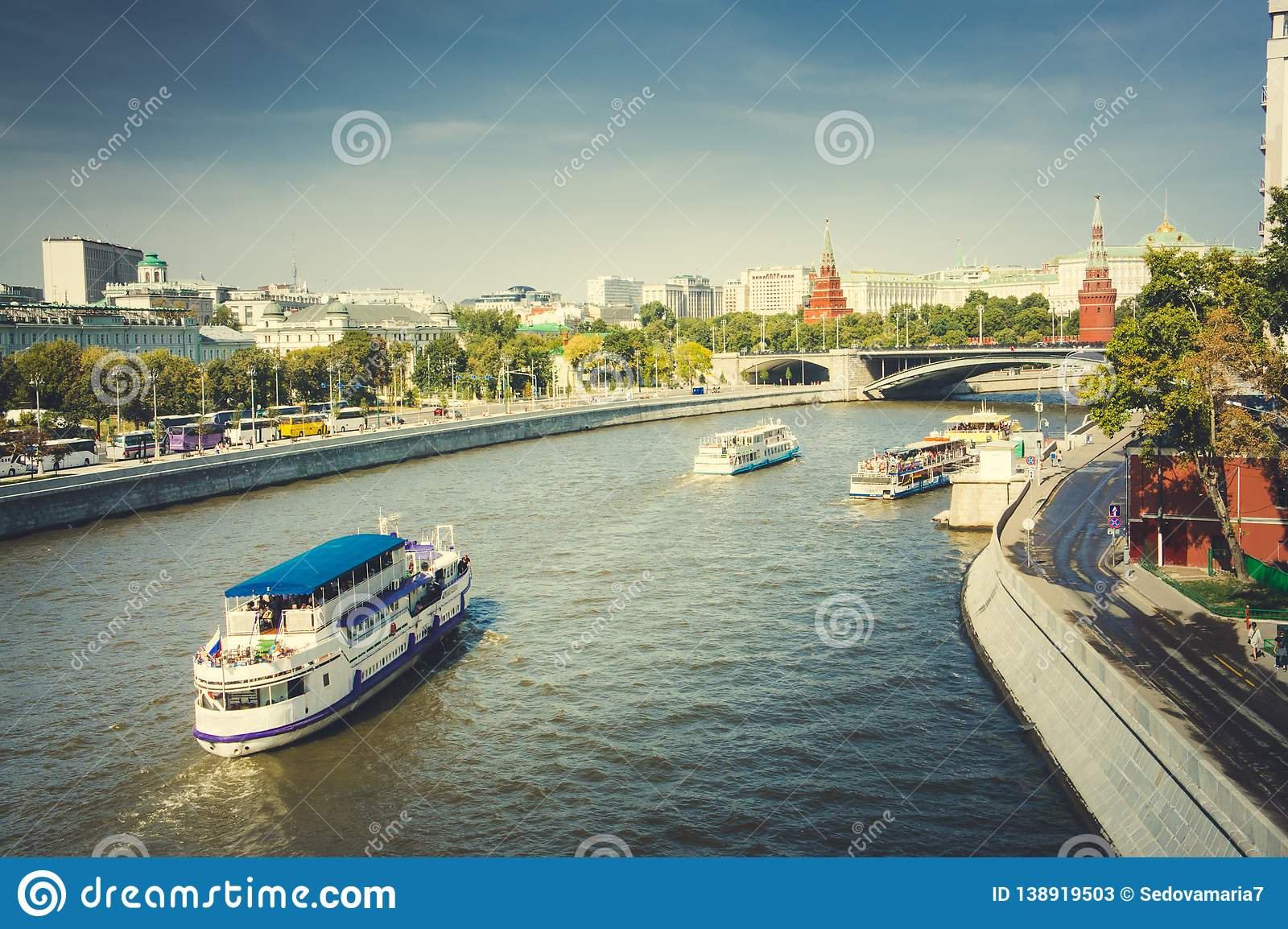 View to Moscow river tourist boats and Kremlin towers, Moscow, Russia