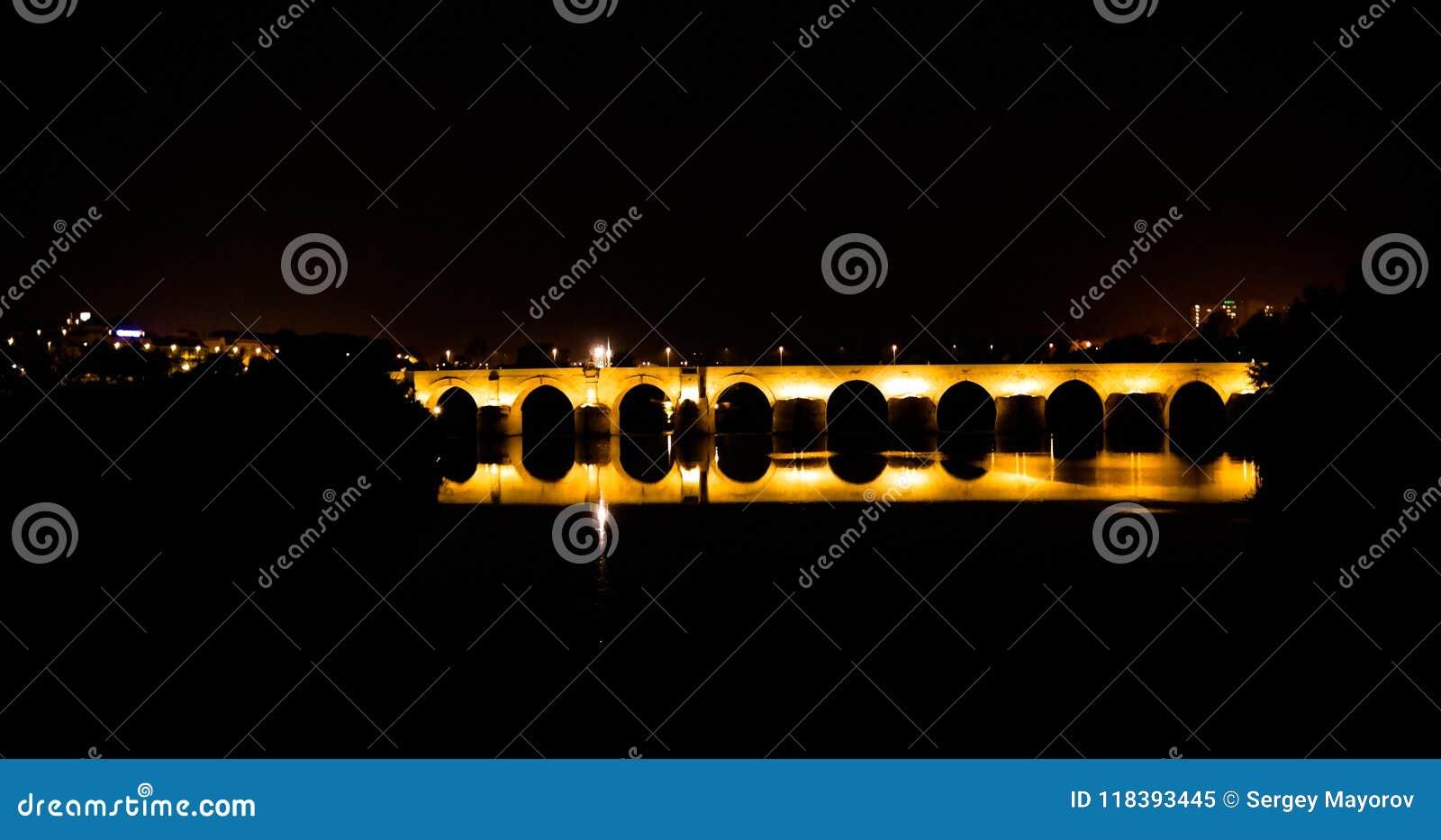 View to Roman bridge in Cordoba at night in Andalusia, Spain