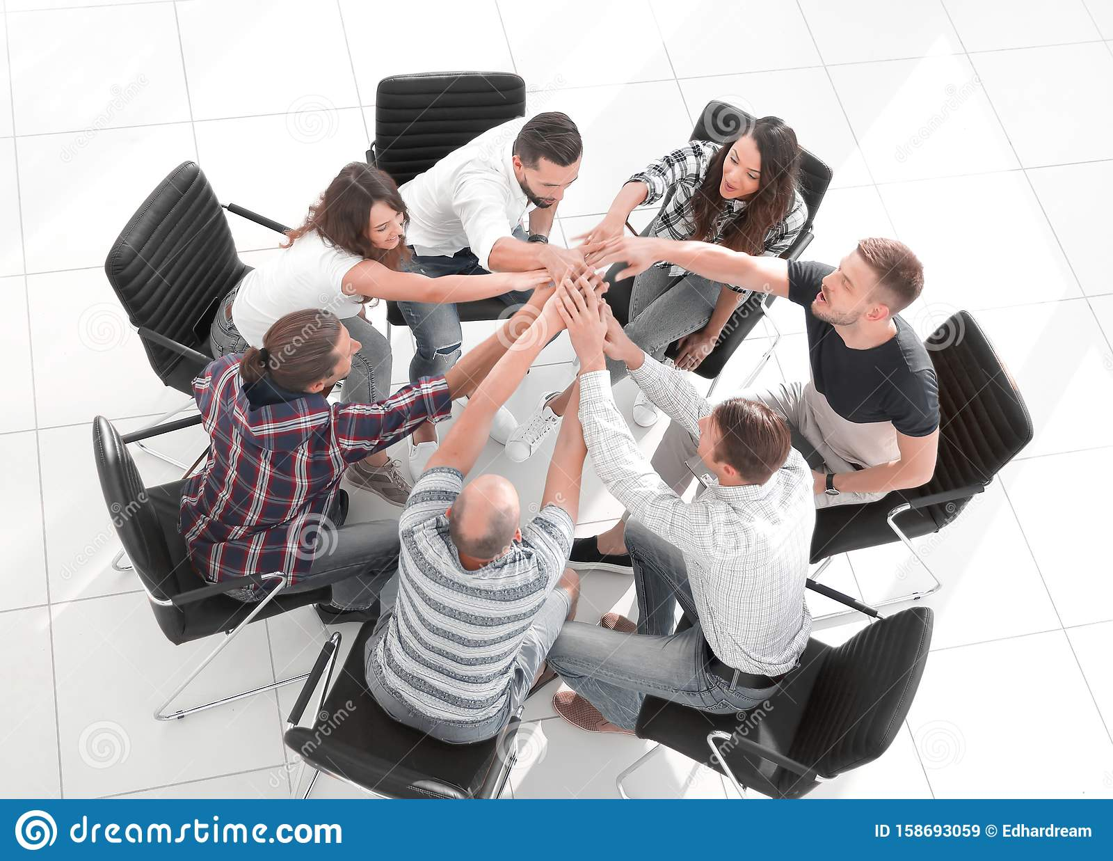 View from the top. business team shows its unity