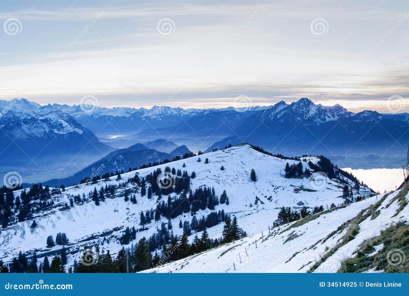view from the top of mt rigi switzerland winter evening stock