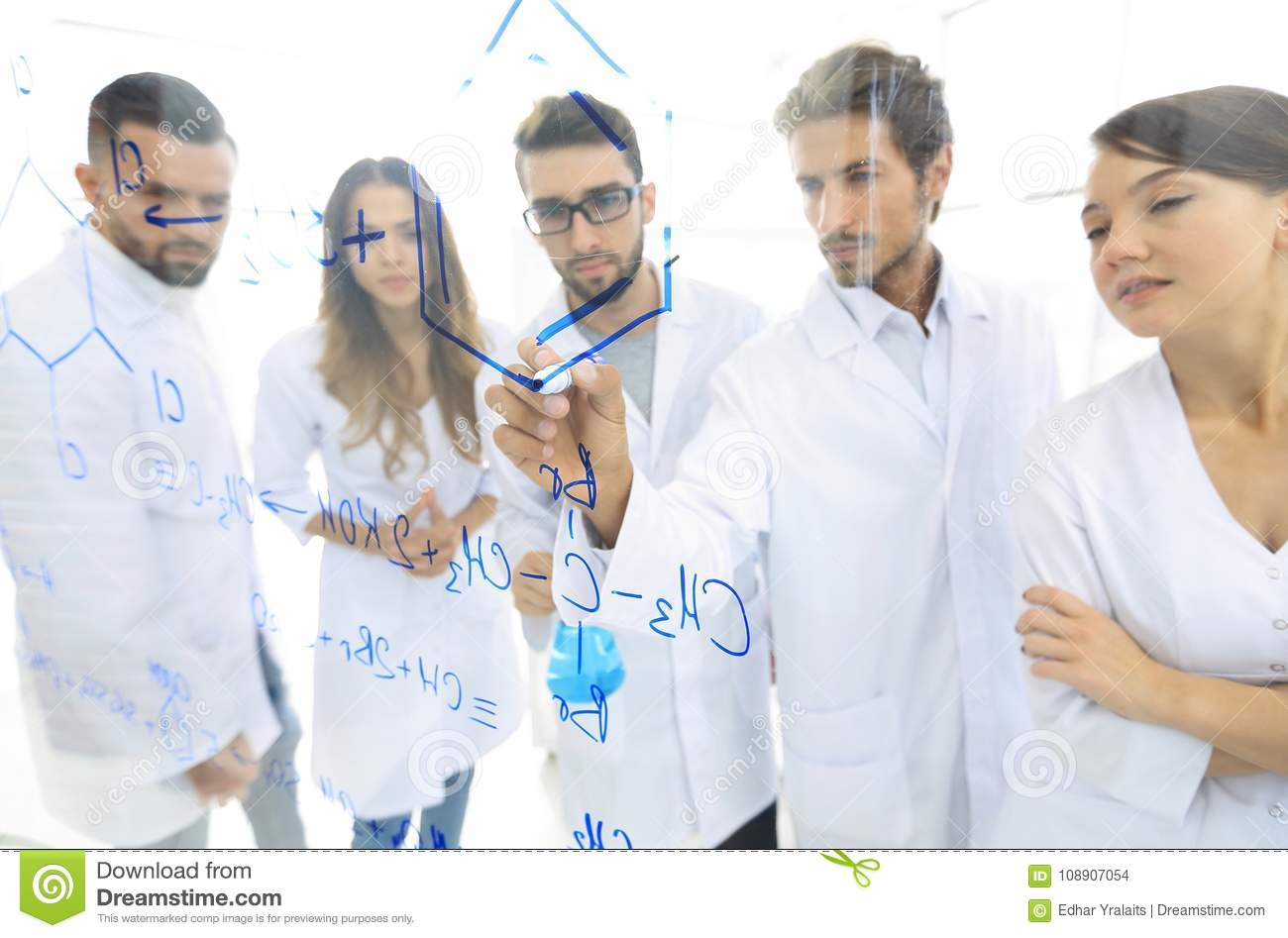 General-view seen trough a transparent board in a chemistry lab of people analyzing information