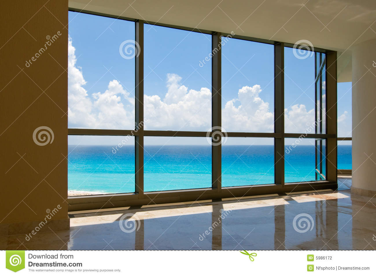 View of tropical beach through hotel windows