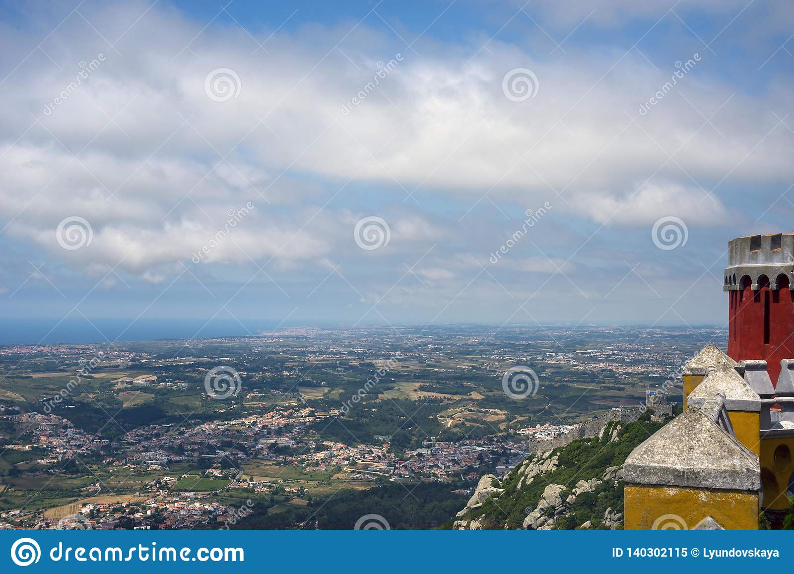 View of the valley, the city and the sky with clouds from the observation deck of the Pena Palace.