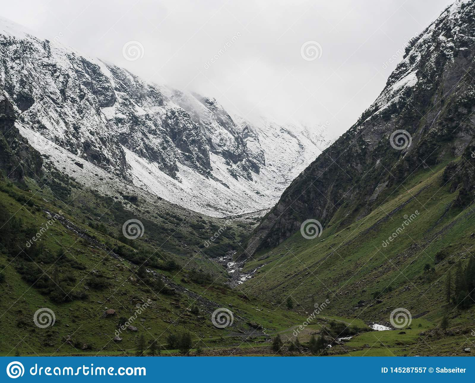 Snow capped mountains valley view
