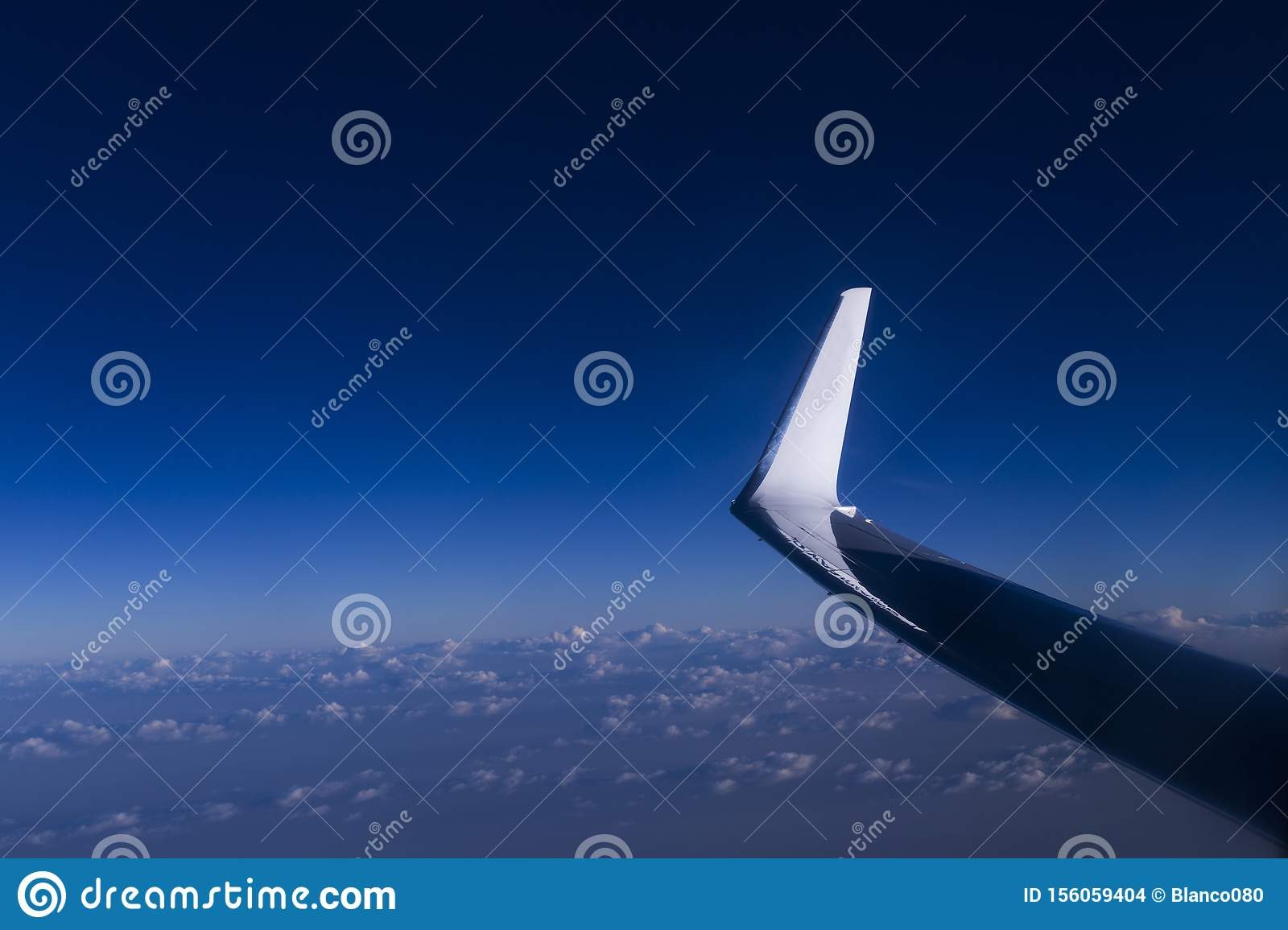 View From Window Seat During Flight Blue Sky With Clouds At
