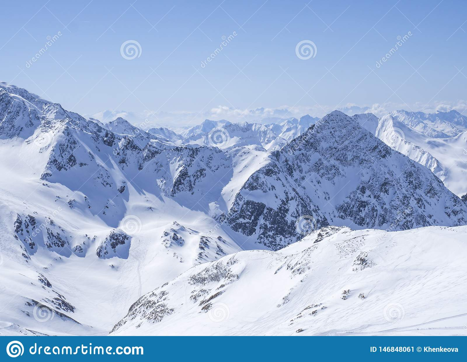 View on winter landscape from the top of Schaufelspitze mountain at Stubai Gletscher ski area with snow covered peaks at