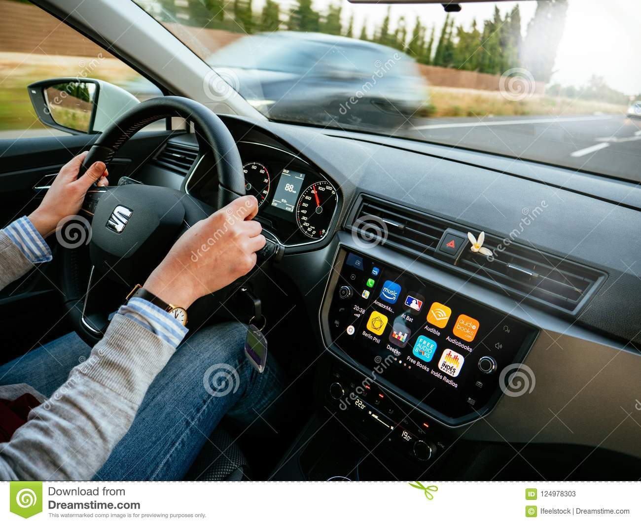 View Of Woman Driving Car On Road Apple Car Editorial Stock
