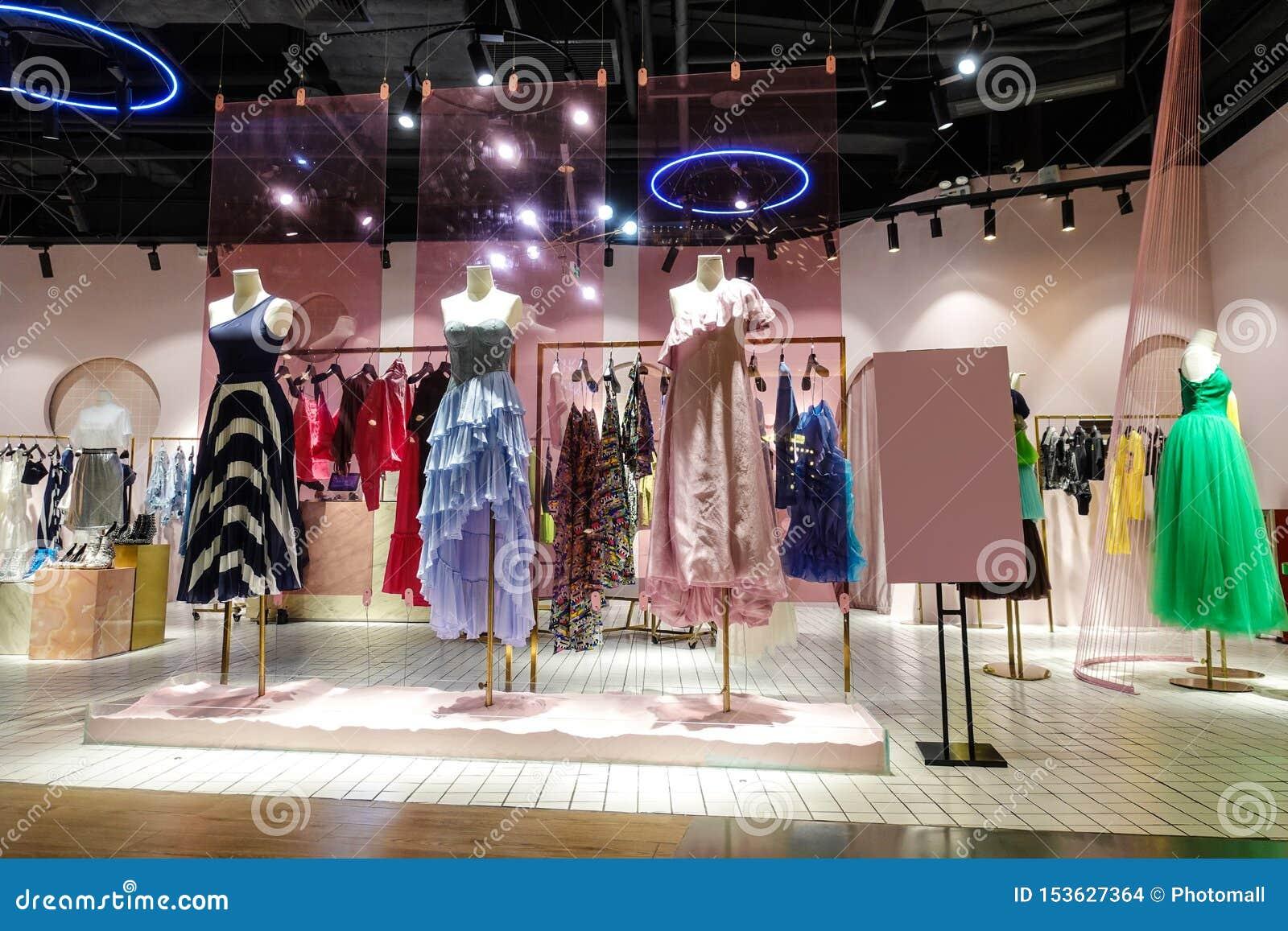 Lady fashion shop interior mannequin front