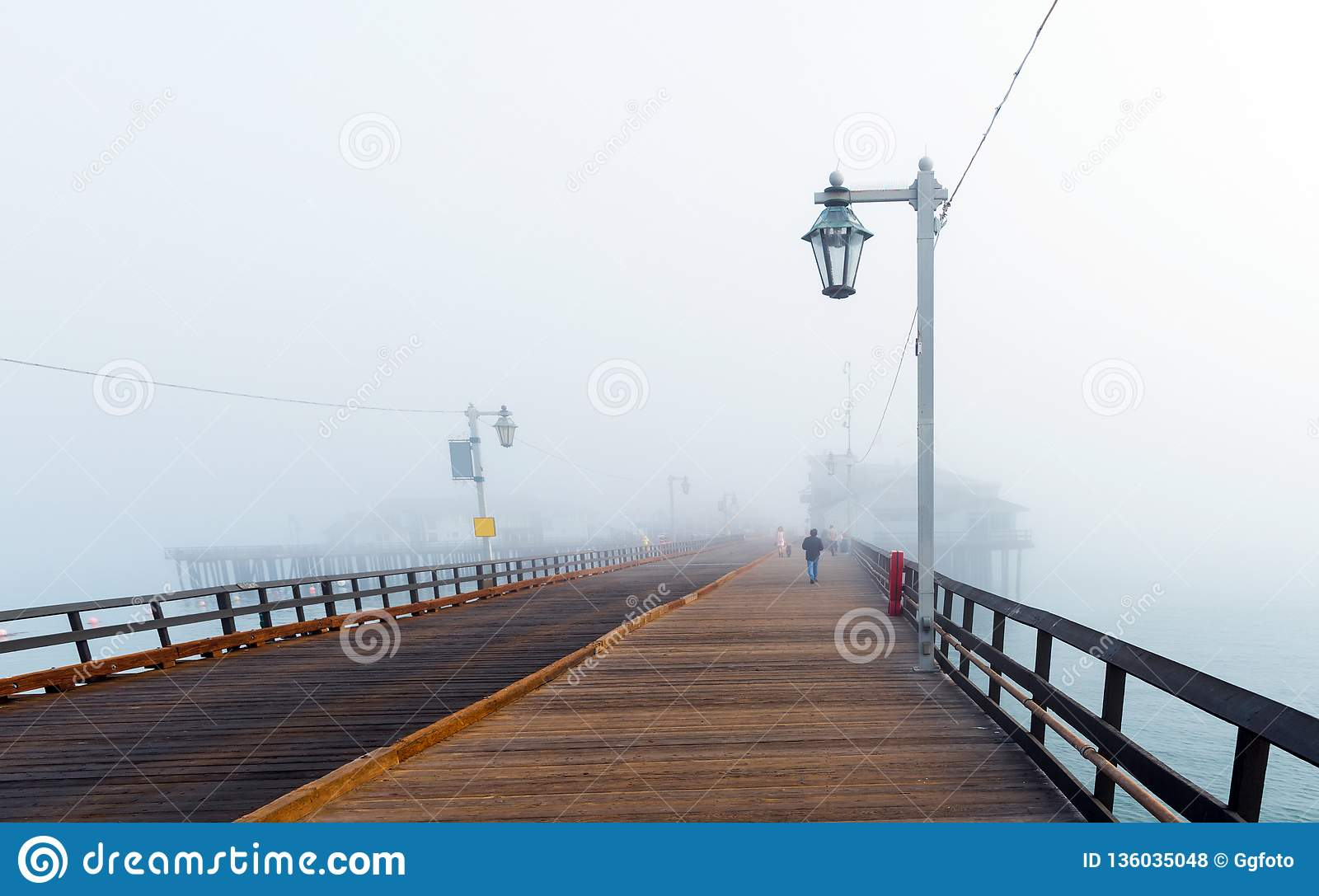 View of the wooden bridge in foggy weather, Santa Barbara, California, USA. Copy space for text