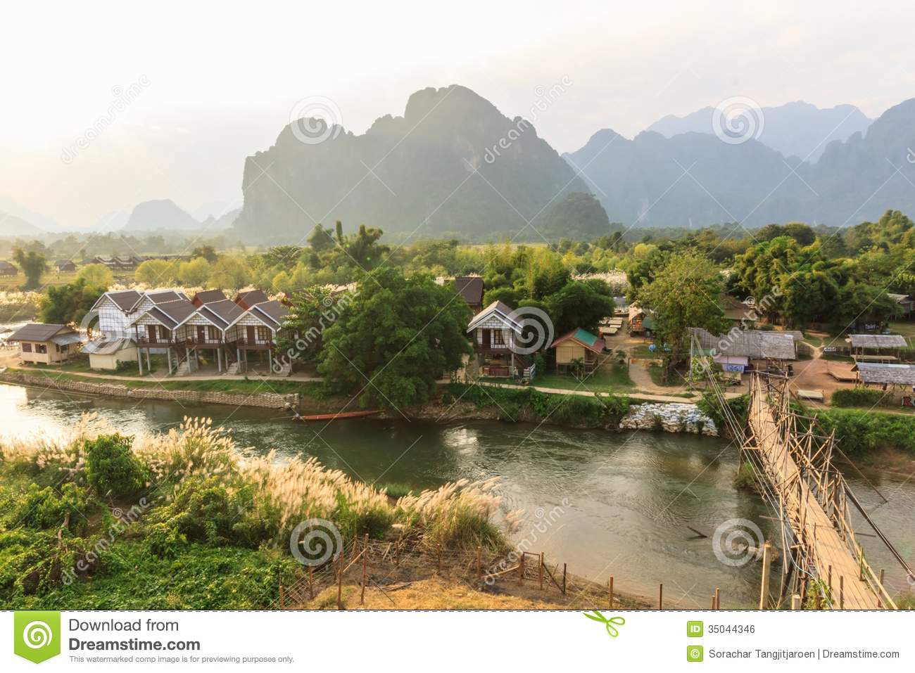 View of wooden bridge over river song vang vieng laos for Domon river guesthouse vang vieng