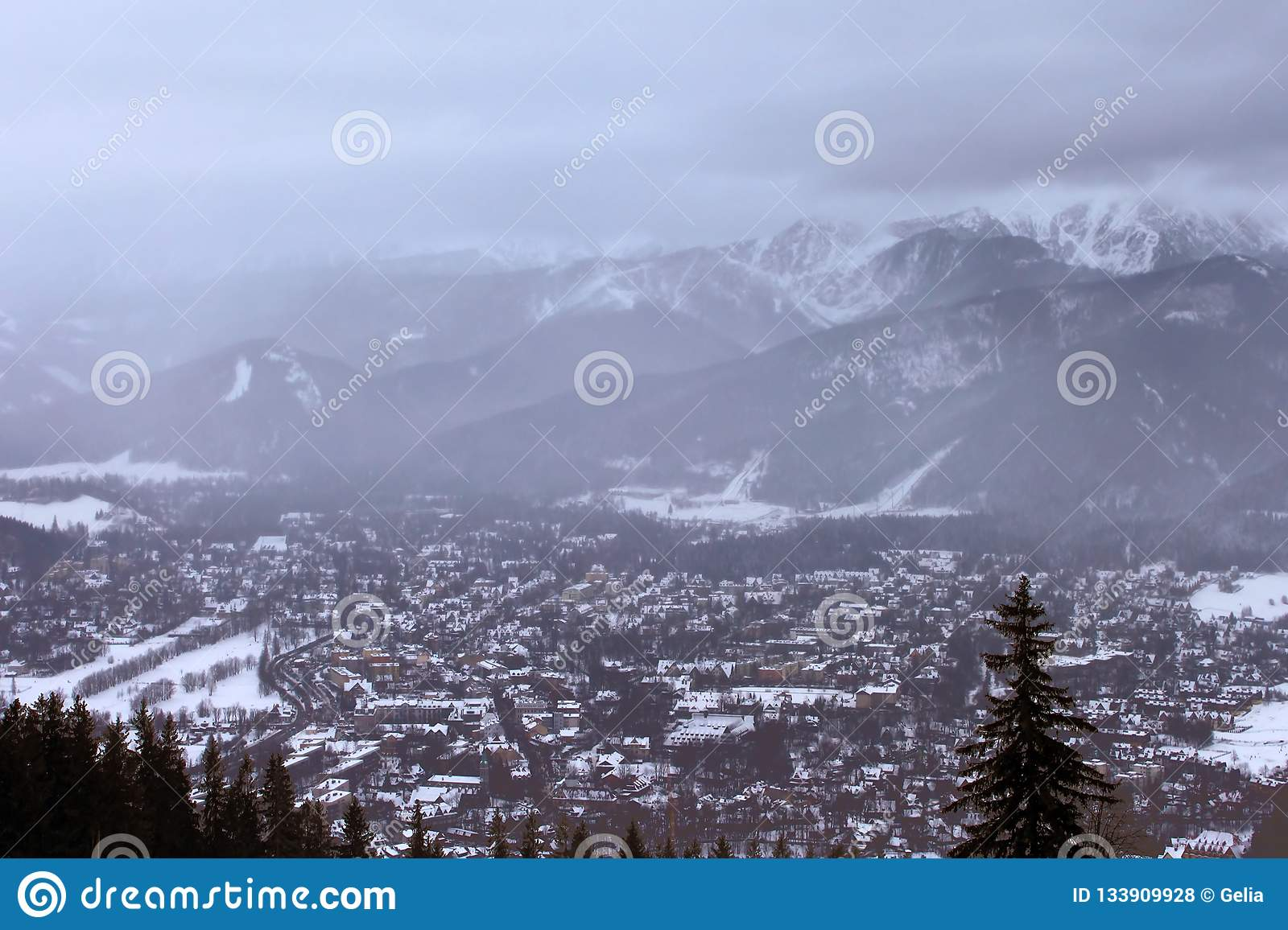 View of Zakopane and Tatra Mountains from Gubalowka in the winter in snowing weather