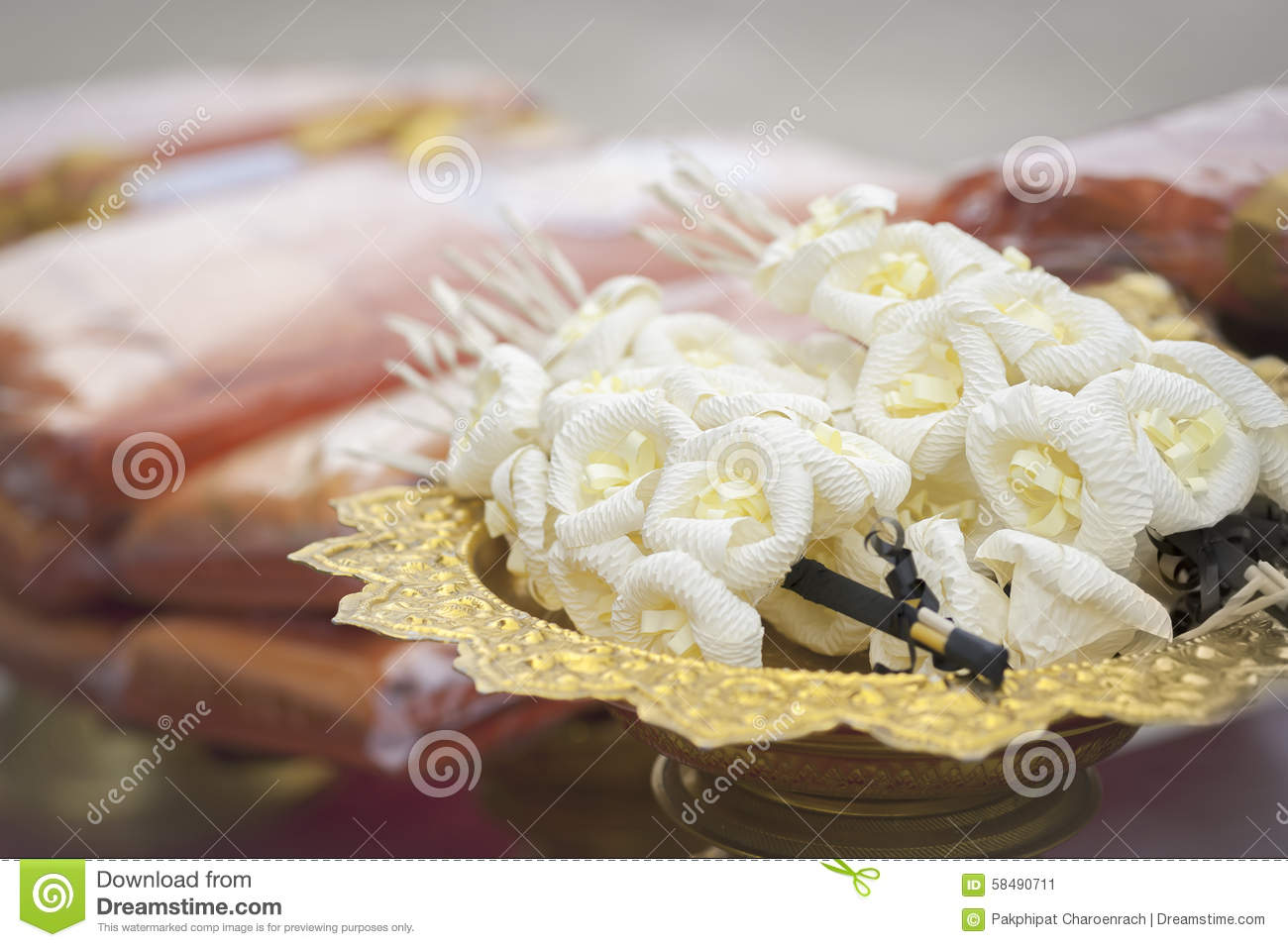 Vignette image of artificial flowers used during a funeral stock vignette image of artificial flowers used during a funeral kind of wood flower to be placed on the site of cremation selective focus izmirmasajfo