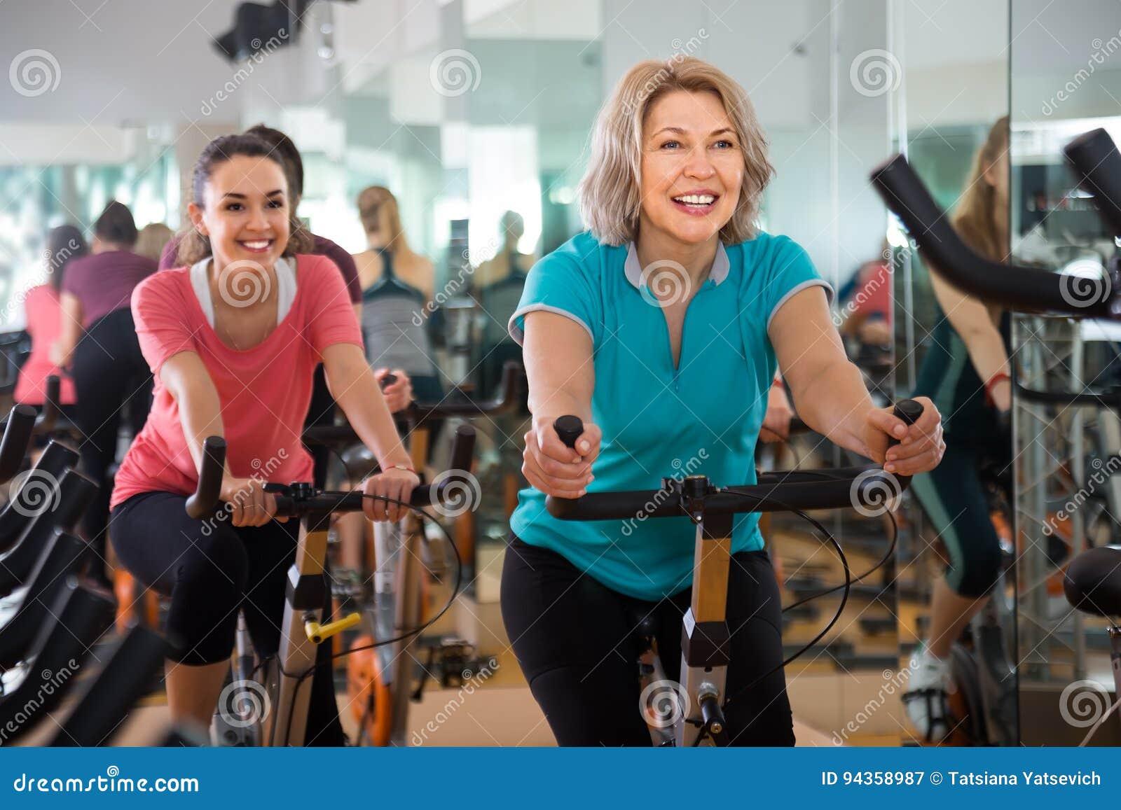 Vigorous Females Of Different Age Training On Exercise Bikes Stock