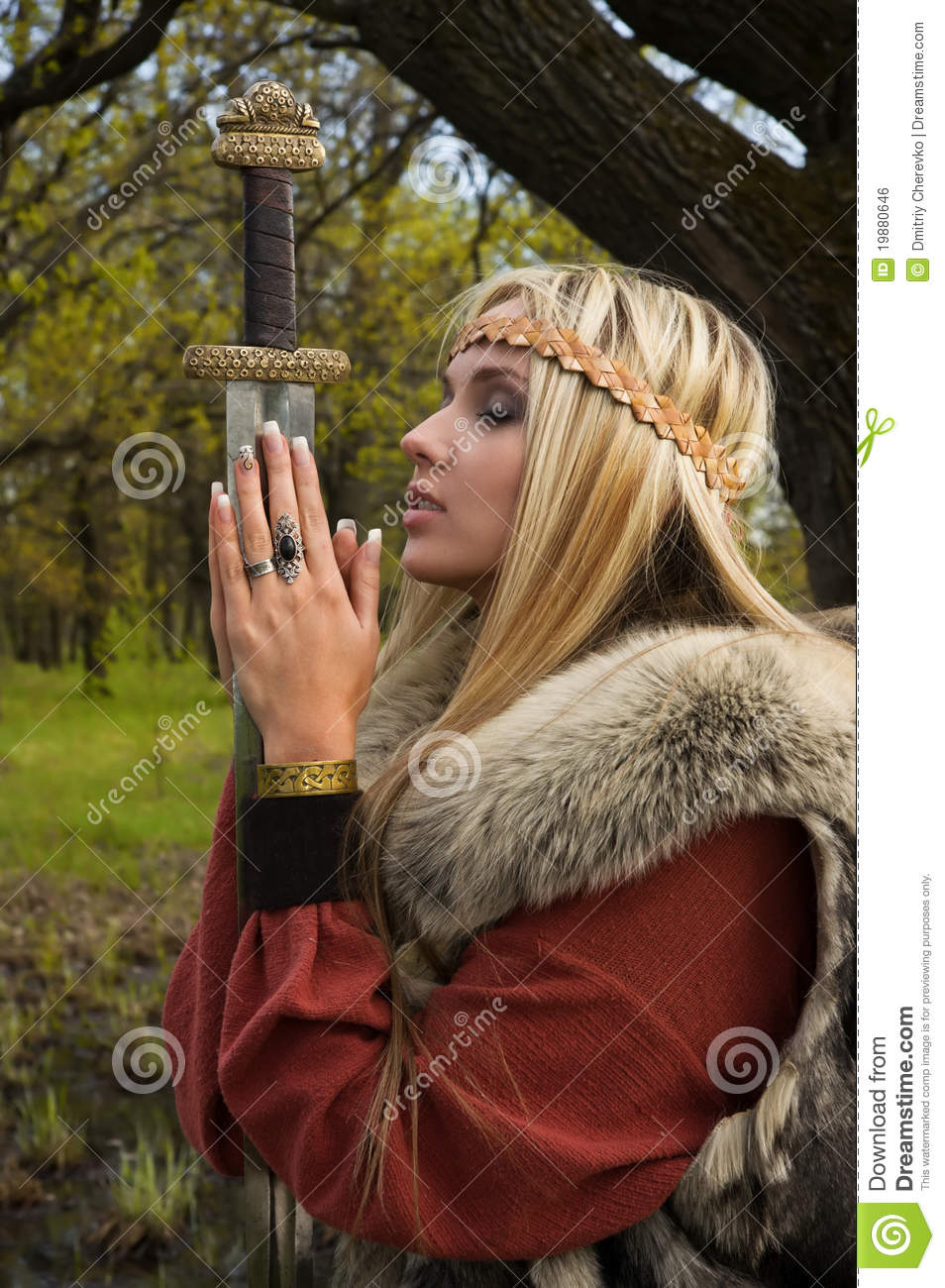 Viking Girl With Sword In A Wood Stock Photo Image Of